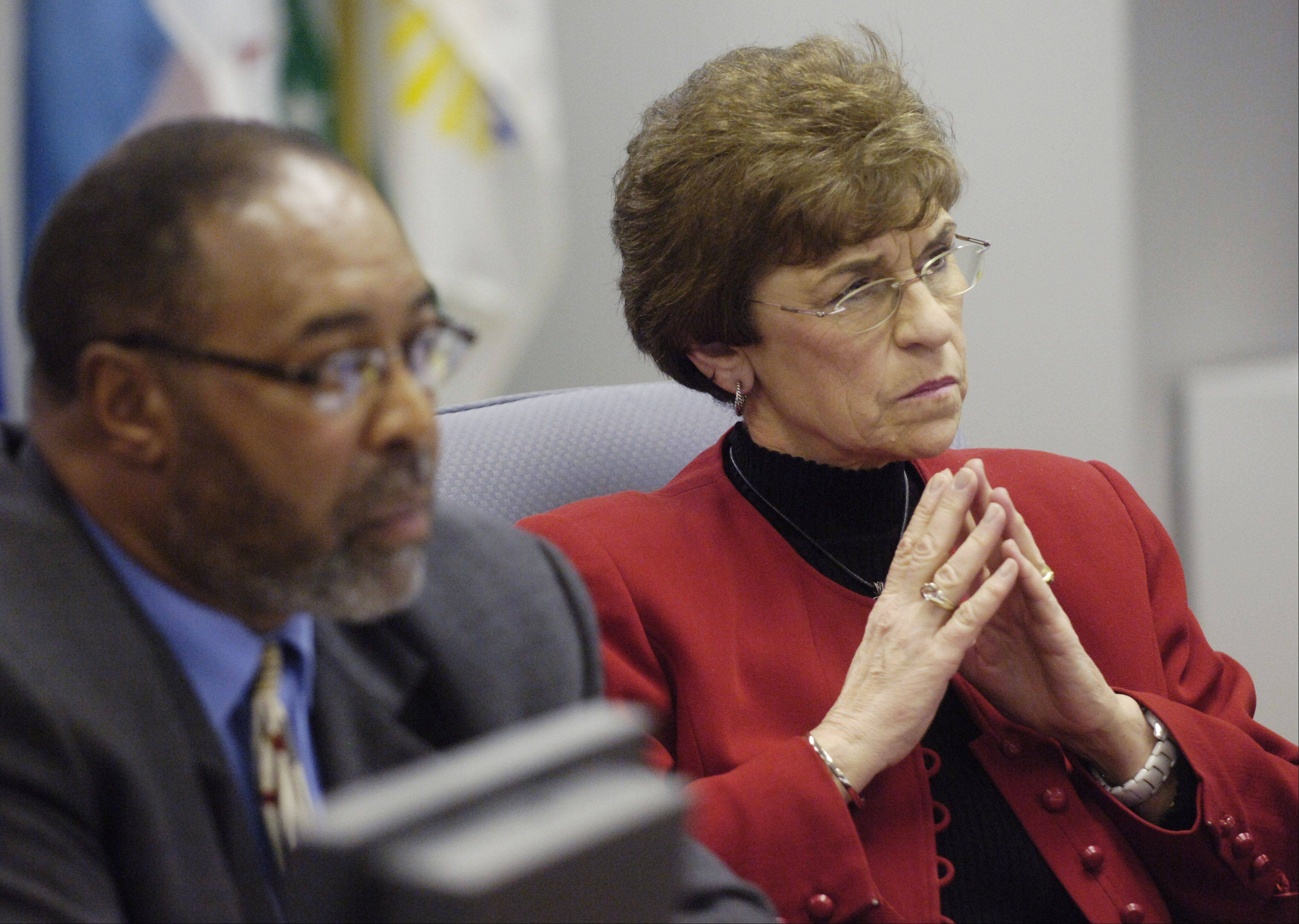 Daily Herald File Photo Metra Director Larry Huggins, shown with director and former Arlington Heights Mayor Arlene Mulder, resigned today.