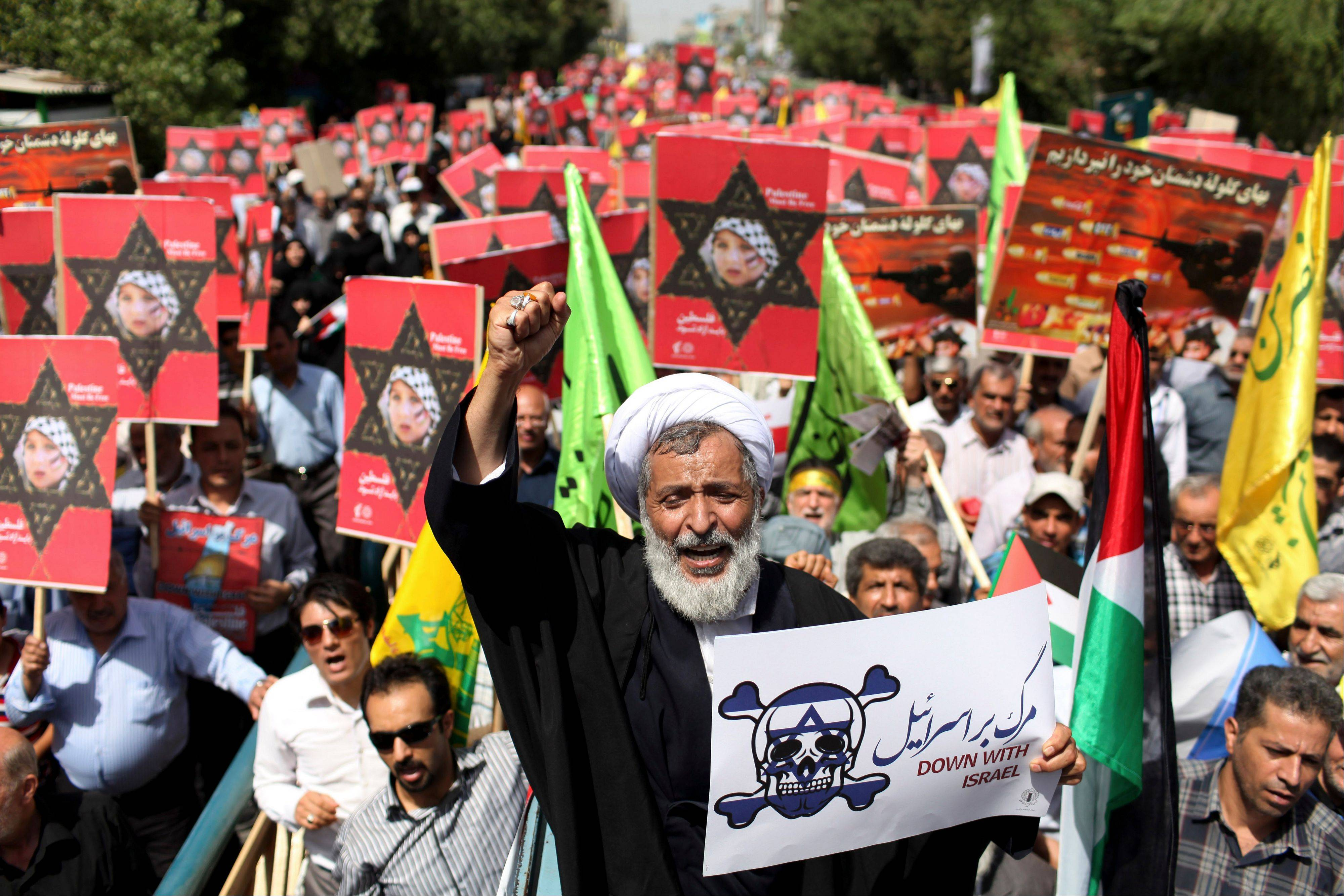 An Iranian cleric holding an anti-Israeli placard chants slogan, while attending an annual pro-Palestinian rally marking Al-Quds (Jerusalem) Day in Tehran, Iran, Friday.