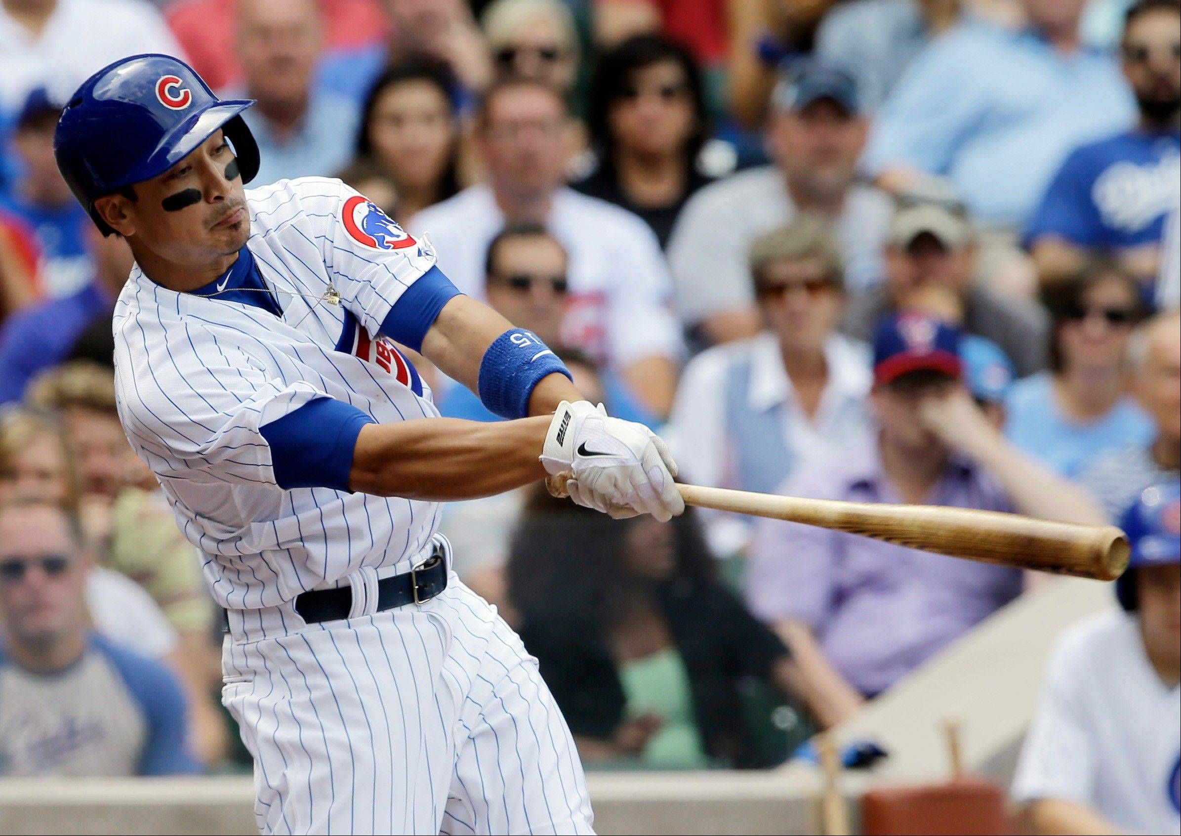 Chicago Cubs' Darwin Barney hits an RBI double against the Los Angeles Dodgers during the second inning of a baseball game on Friday, Aug. 2, 2013, in Chicago. (AP Photo/Nam Y. Huh)