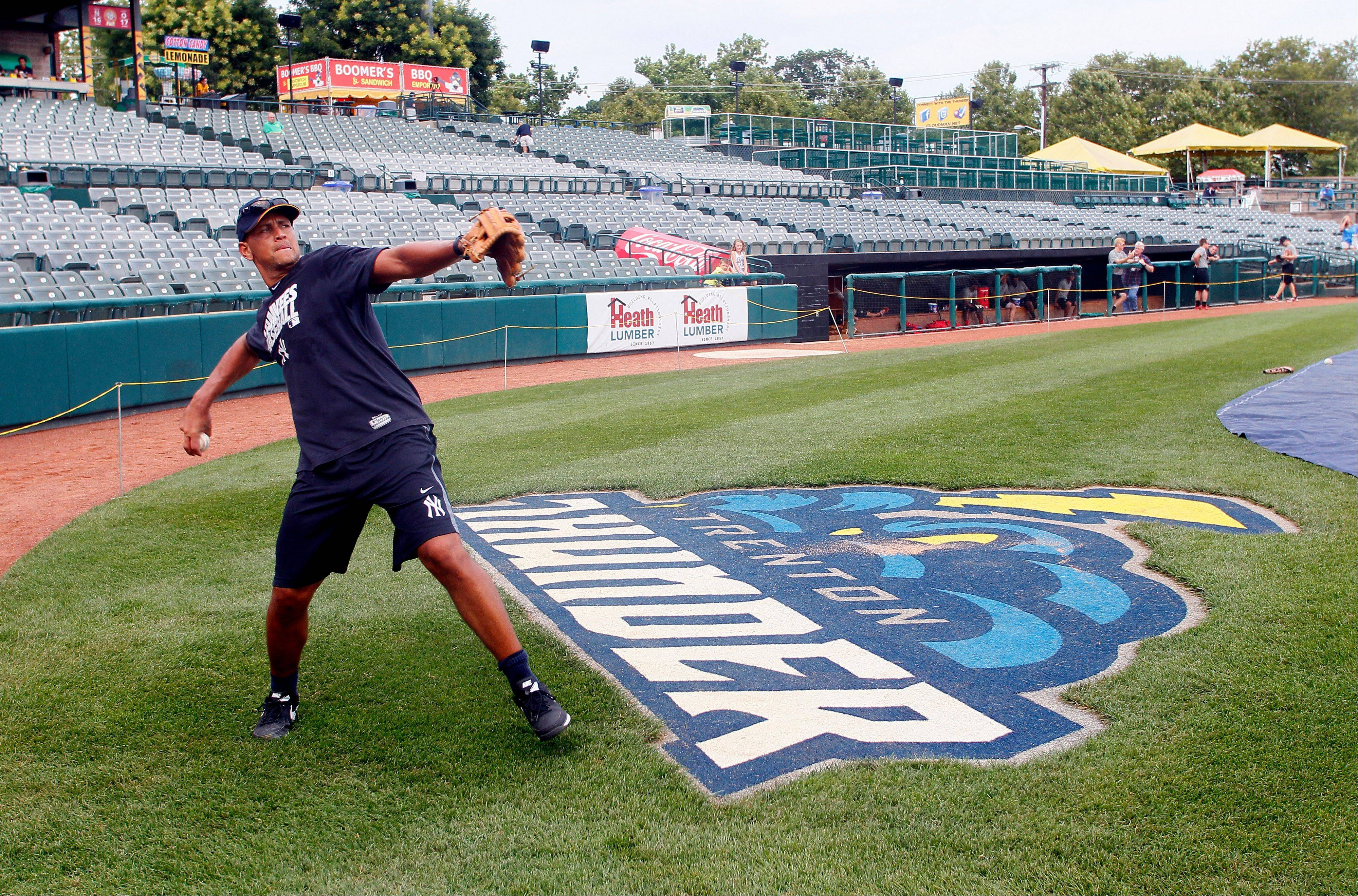 New York Yankees' Alex Rodriguez warms up before the start of a Class AA baseball game with the Trenton Thunder against the Reading Phillies, Friday, Aug. 2, 2013, Trenton, N.J. (AP Photo/Tom Mihalek)