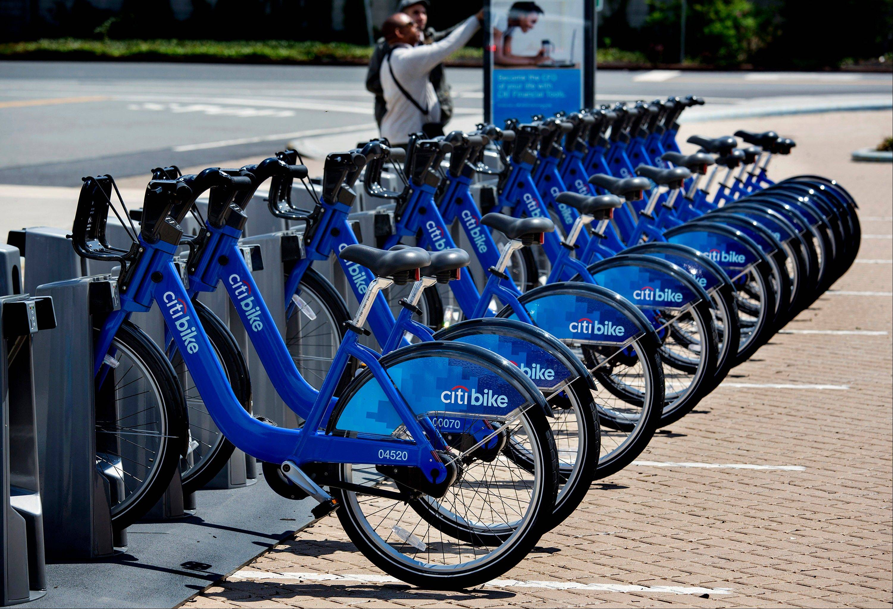 Bicycles that are part of the NYC Bike Share program are lined up at a dock and lock station at the Brooklyn Navy Yards in New York. Chicago launched its bike sharing programon June 28.