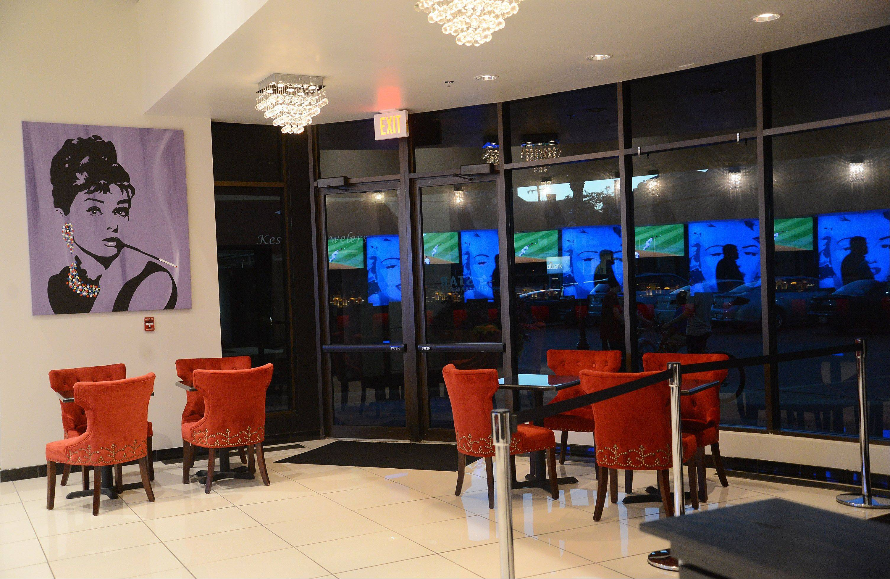 The revamped lobby at the Star Cinema Grill features plush seating and tables for sharing drinks and appetizers before or after a show.