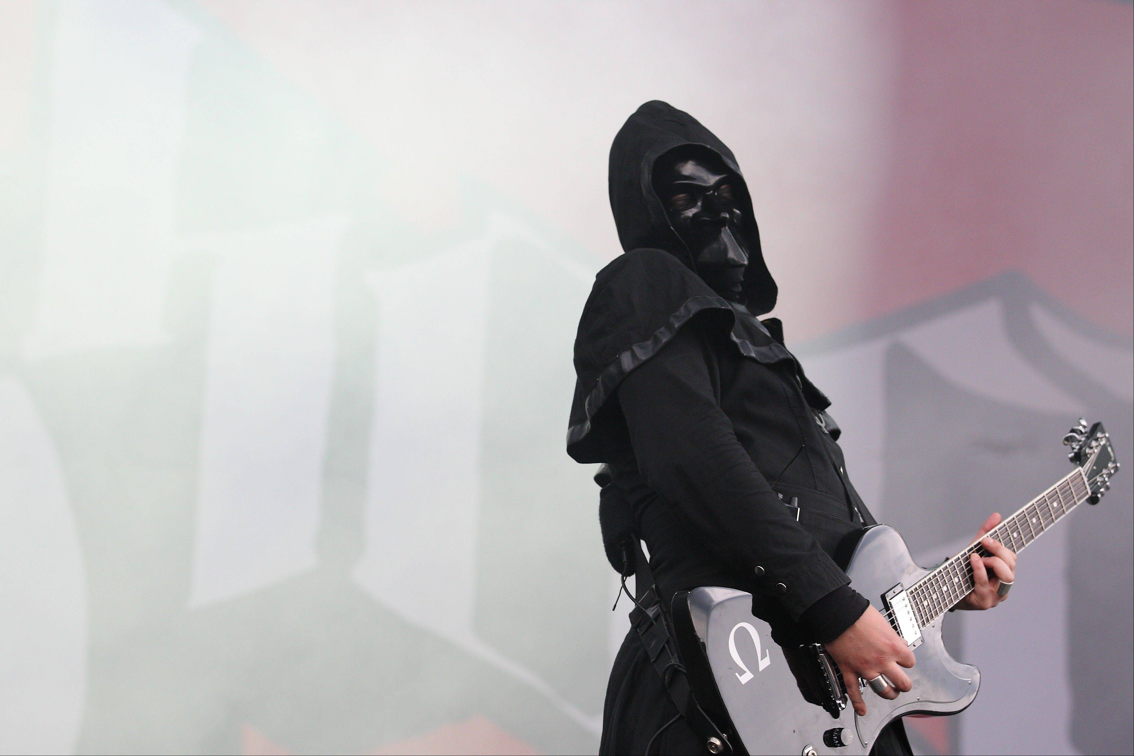 The Swedish band Ghost BC performs on day 1 of Lollapalooza 2013 at Grant Park in Chicago Friday.