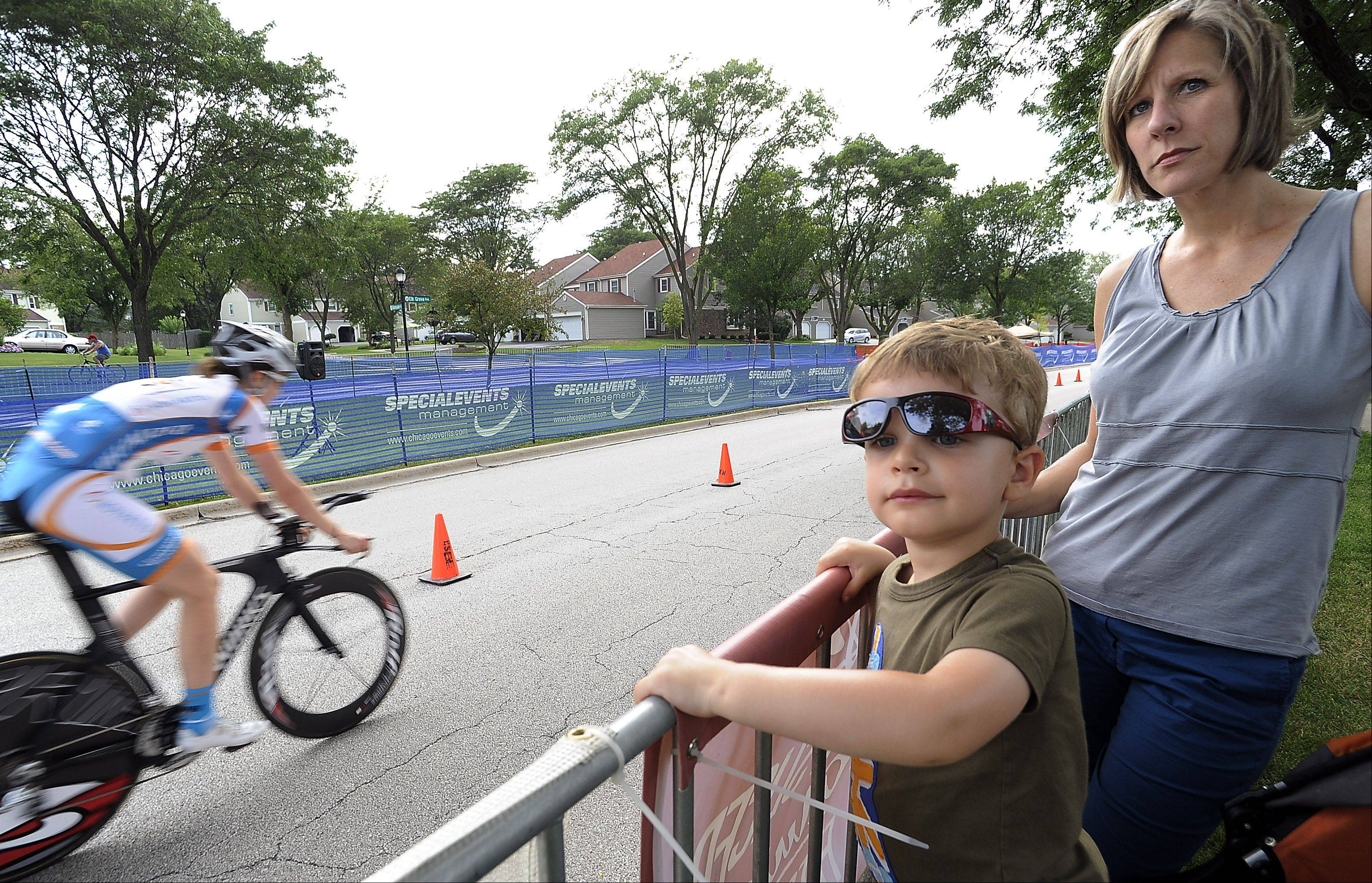 Stephanie Spackey and her son Grant, 3, of Elk Grove watch the women bikers during the 2013 Alexian Brothers Tour of Elk Grove Woodfield Chicago Northwest Convention Bureau Pro Women's time trials on day one of the three-day event on Friday.