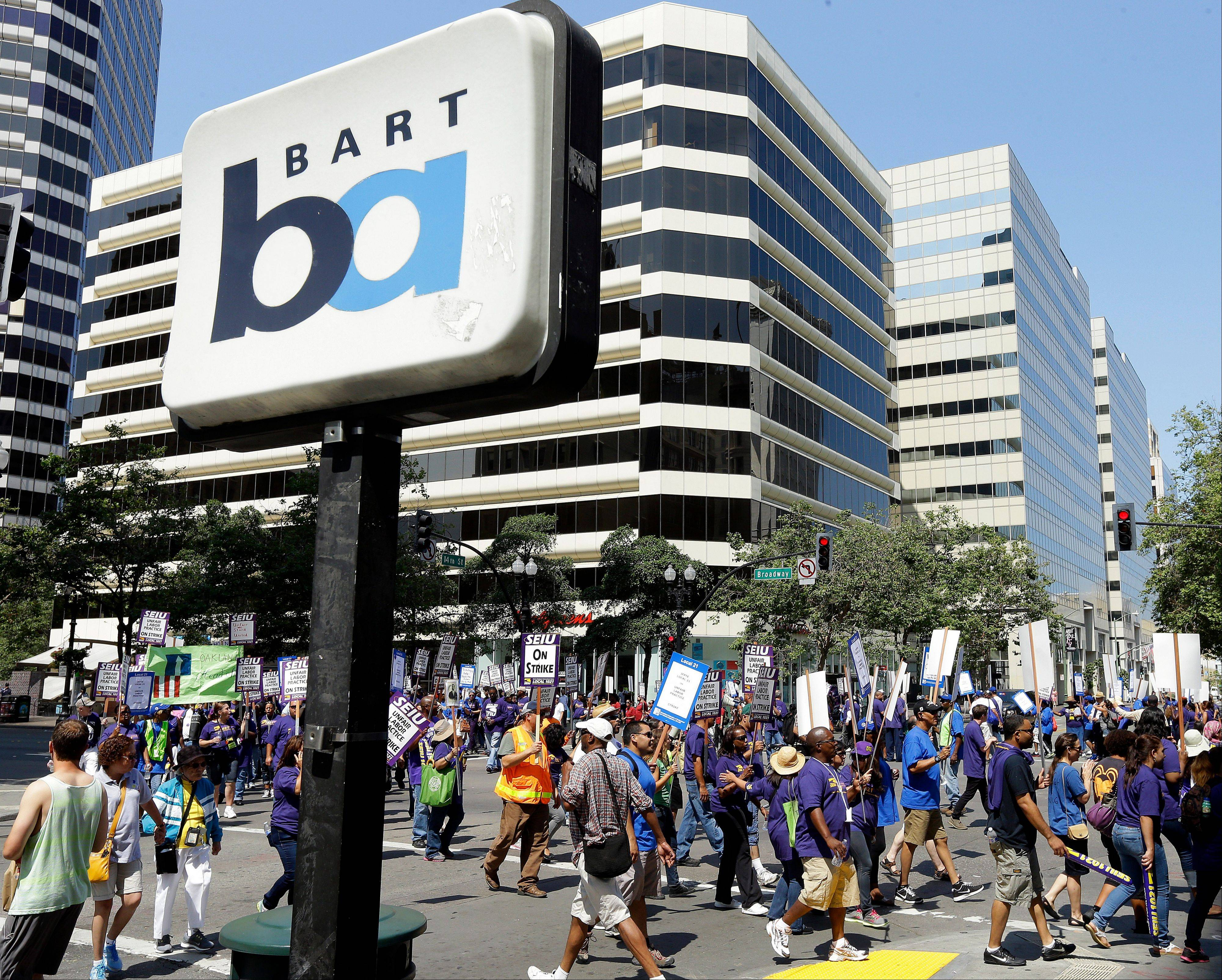 Associated Press/July 1, 2013Striking Bay Area Rapid Transit workers picket as they close the intersection of 14th & Broadway.