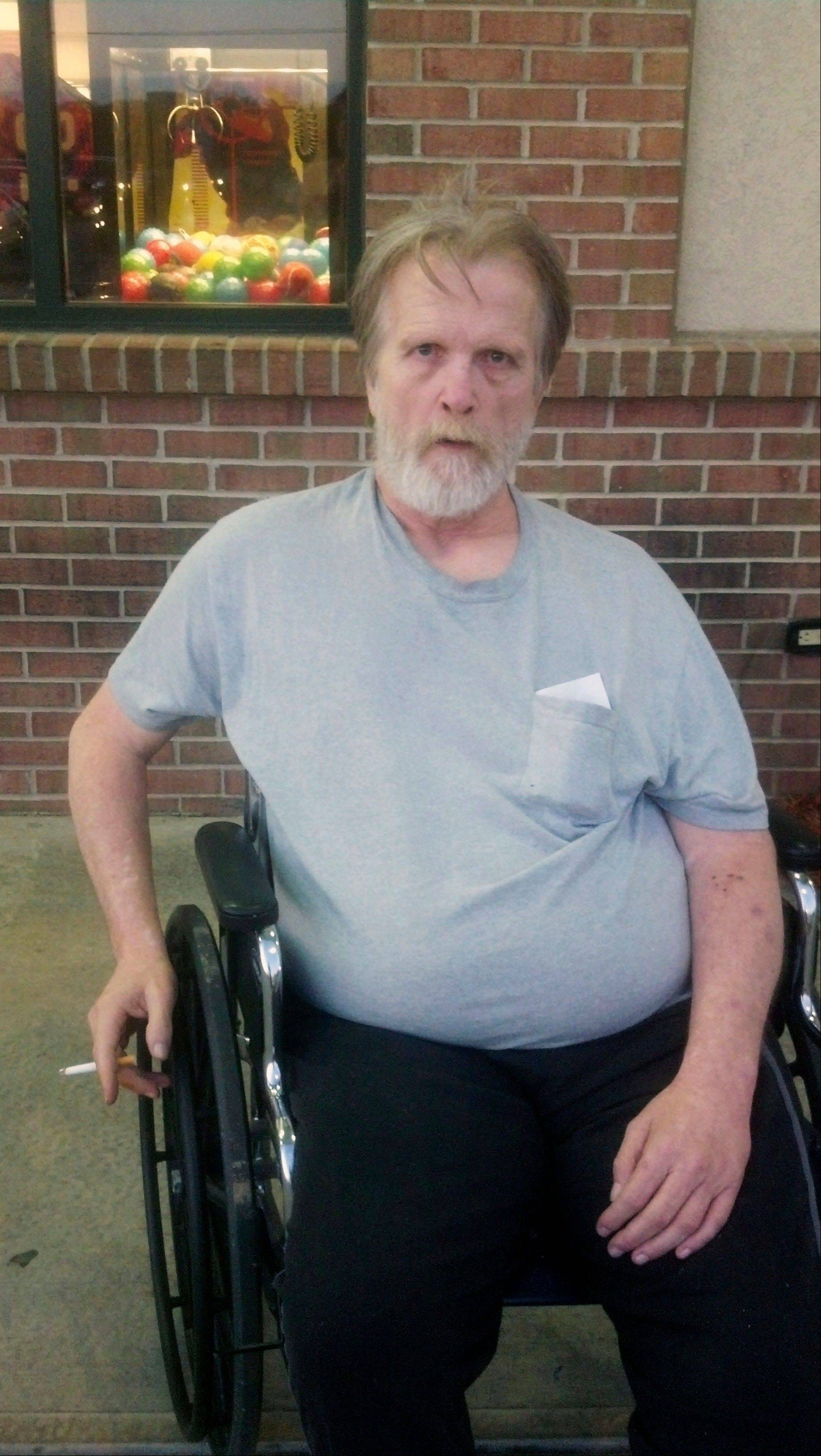 Thomas Hearty, 56, sits outside a Denny's at a truck stop in Alorton, Ill., on July 31 after workers from the Lebanon Care Center dropped him off there.