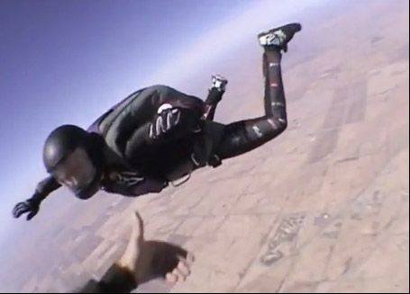 Stephanie Eggum, 32, of Elgin sky dives over Arizona in this video image. Eggum died Thursday during a jump near Ottawa, Ill.