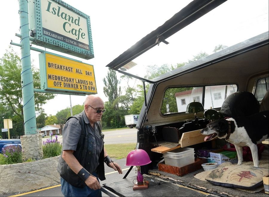 Tony Farina makes a stop at one of his favorite places for breakfast, the Island Cafe in Island Lake with his dog Sydny.