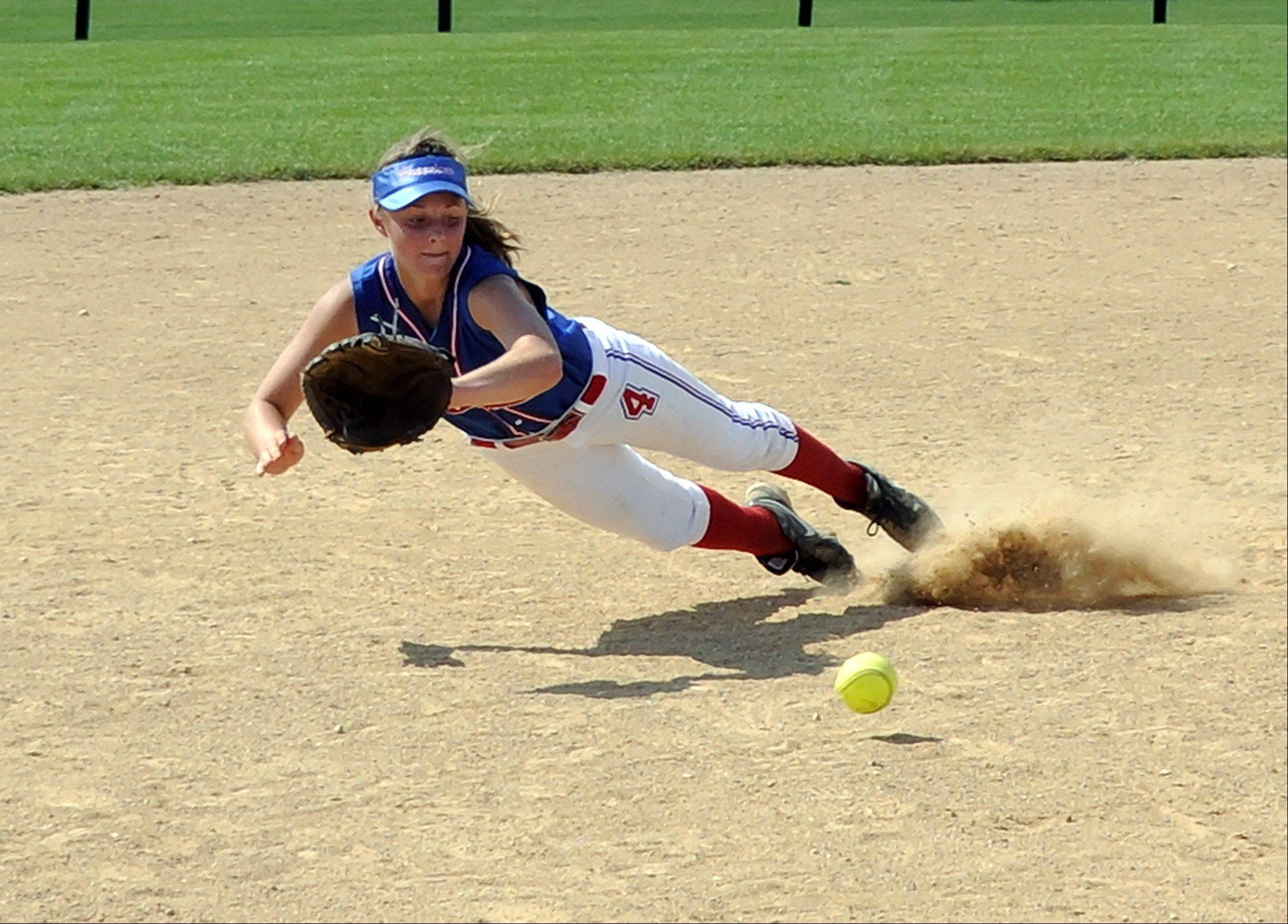 The Lake County Freedom shortstop leaves her feet to make a diving stop and then successfully gets the runner at first base.