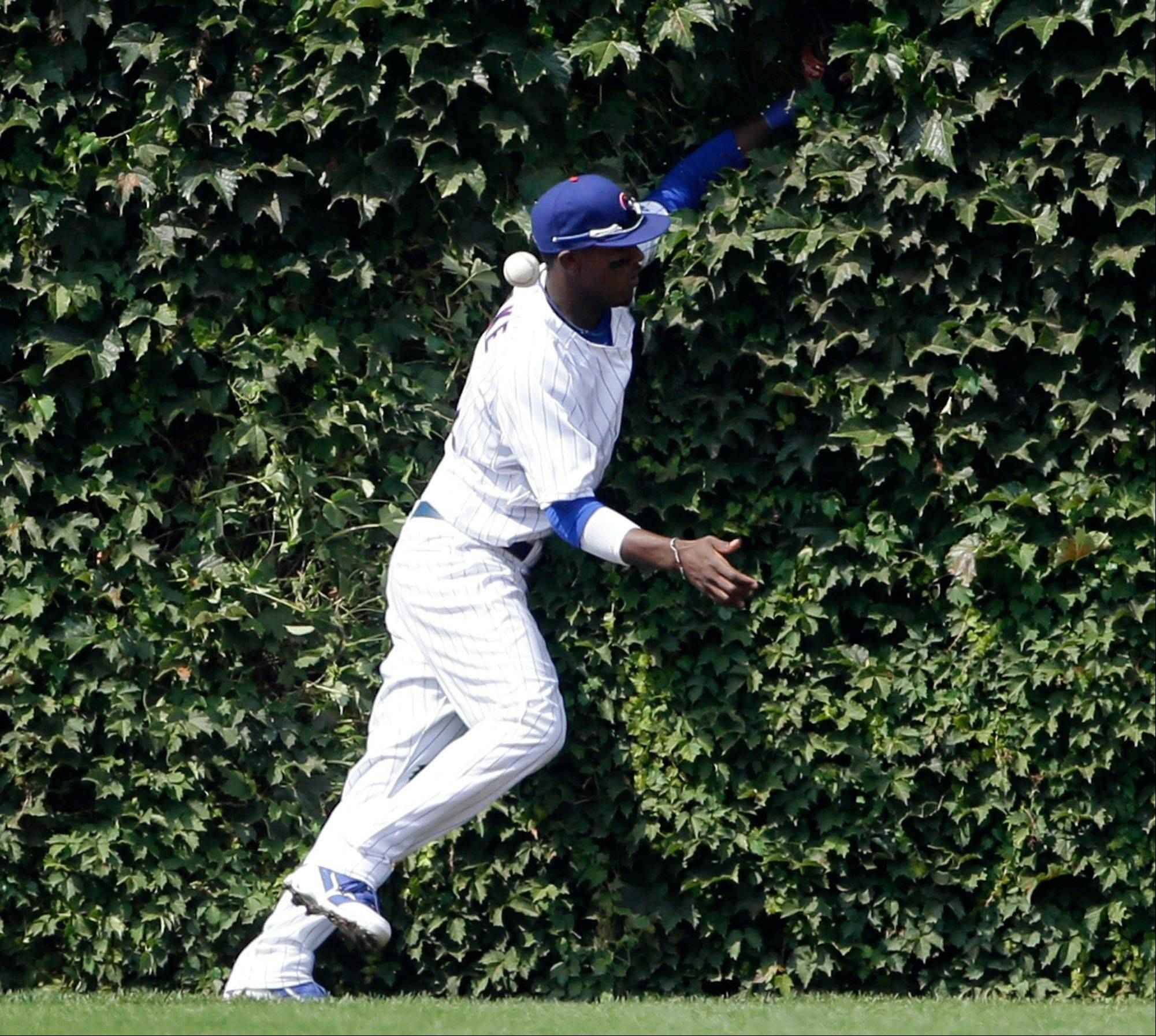 Chicago Cubs left fielder Junior Lake can't make the catch on a double hit Los Angeles Dodgers' Adrian Gonzalez during the first inning of a baseball game on Friday, Aug. 2, 2013, in Chicago.