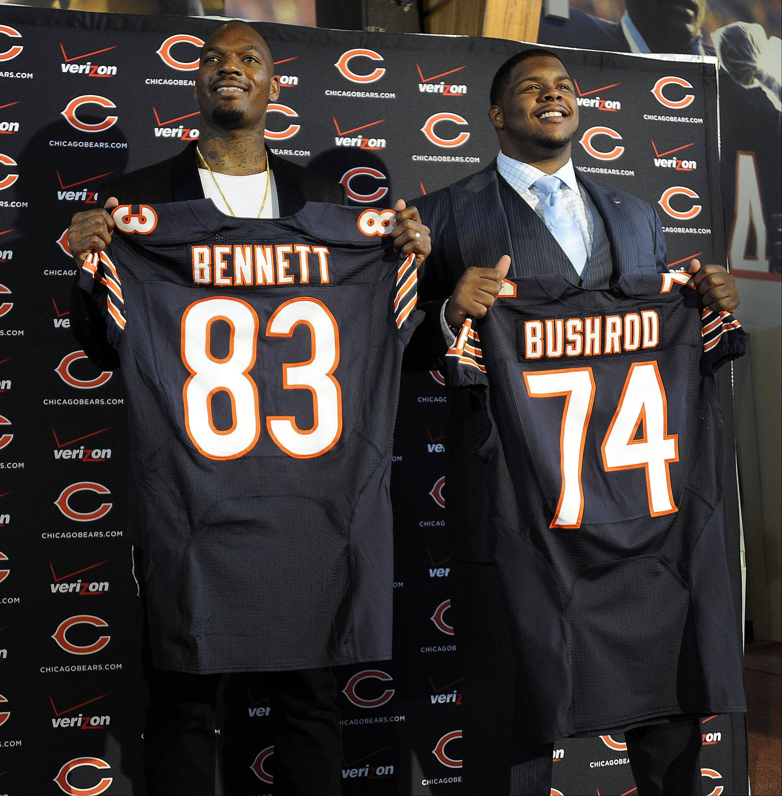 Martellus Bennettm left and Jermon Bushrod display their Bears jerseys earlier this year.