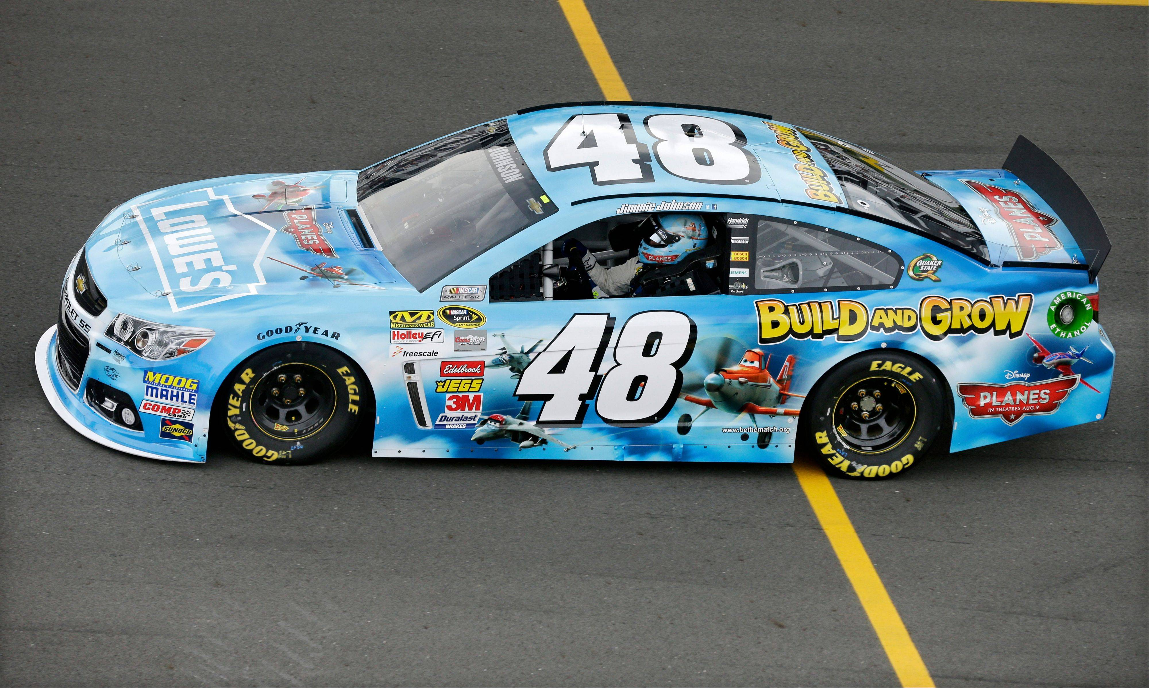 Jimmie Johnson drives into the pits after qualifying for Sunday's NASCAR Sprint Cup Series auto race, Friday Aug. 2, 2013, in Long Pond, Pa. Johnson qualified on the pole with a speed of 180.654 mph.