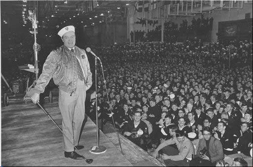 Comedian Bob Hope entertains sailors of the U.S. 6th Fleet Saratoga at the flagship�s anchorage in the southern Italian port of Gaeta, on Dec. 19, 1970. Hope was on his annual United Service Organizations (USO) tour to entertain Americans serving overseas. Hope, beloved actor and comedian, who died 10 years ago at age 100, is being celebrated at the National World War II Museum in New Orleans, where the World Golf Hall of Fame & Museum has brought the �Bob Hope: An American Treasure� traveling exhibition. The exhibit officially opens Saturday Aug. 3.