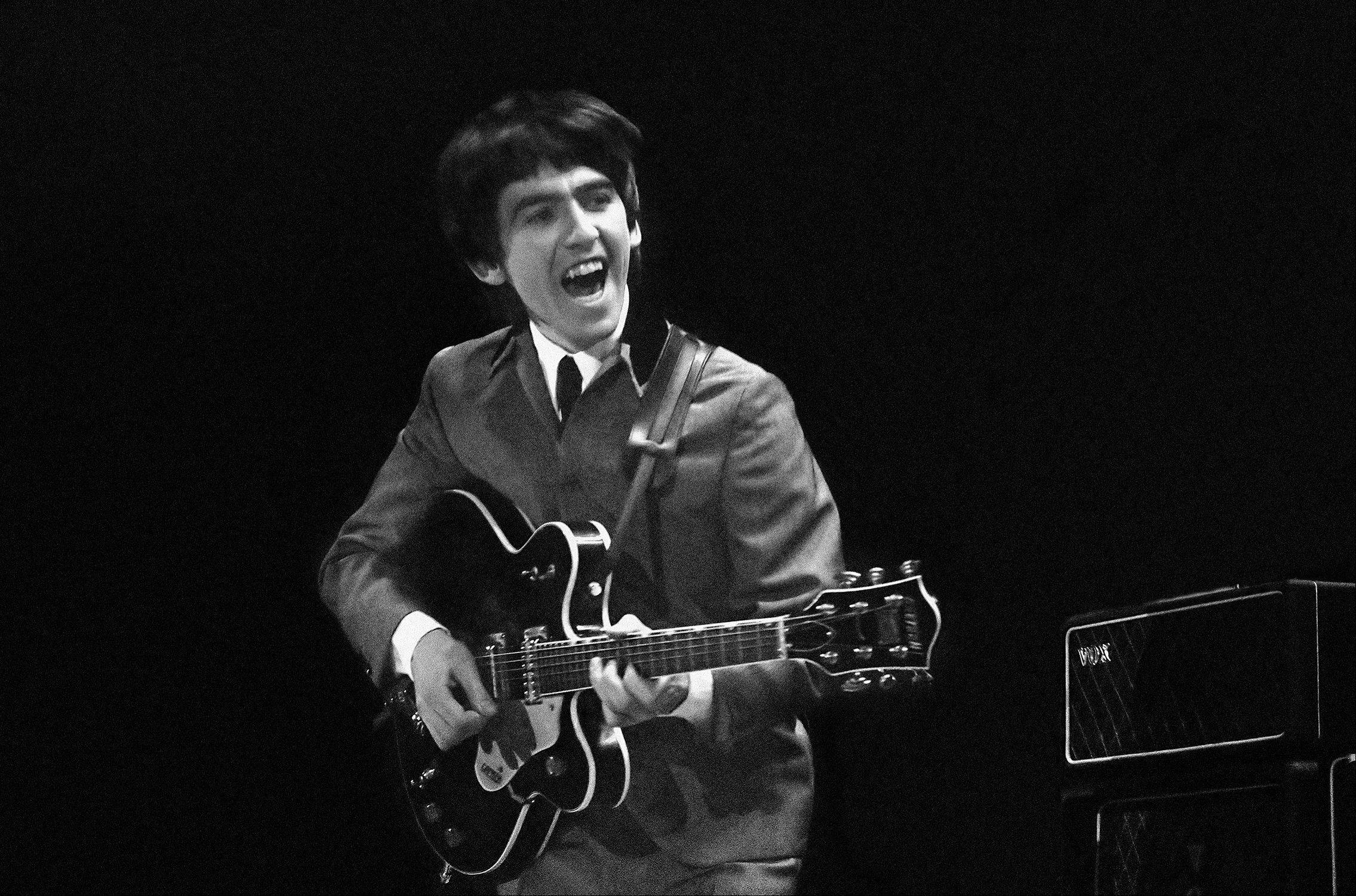 This Feb. 11, 1964 image provided by the David Anthony Fine Art gallery in Taos, N.M., shows a photograph of George Harrison taken by photographer Mike Mitchell during the Beatles first live U.S. concert at the Washington Coliseum.