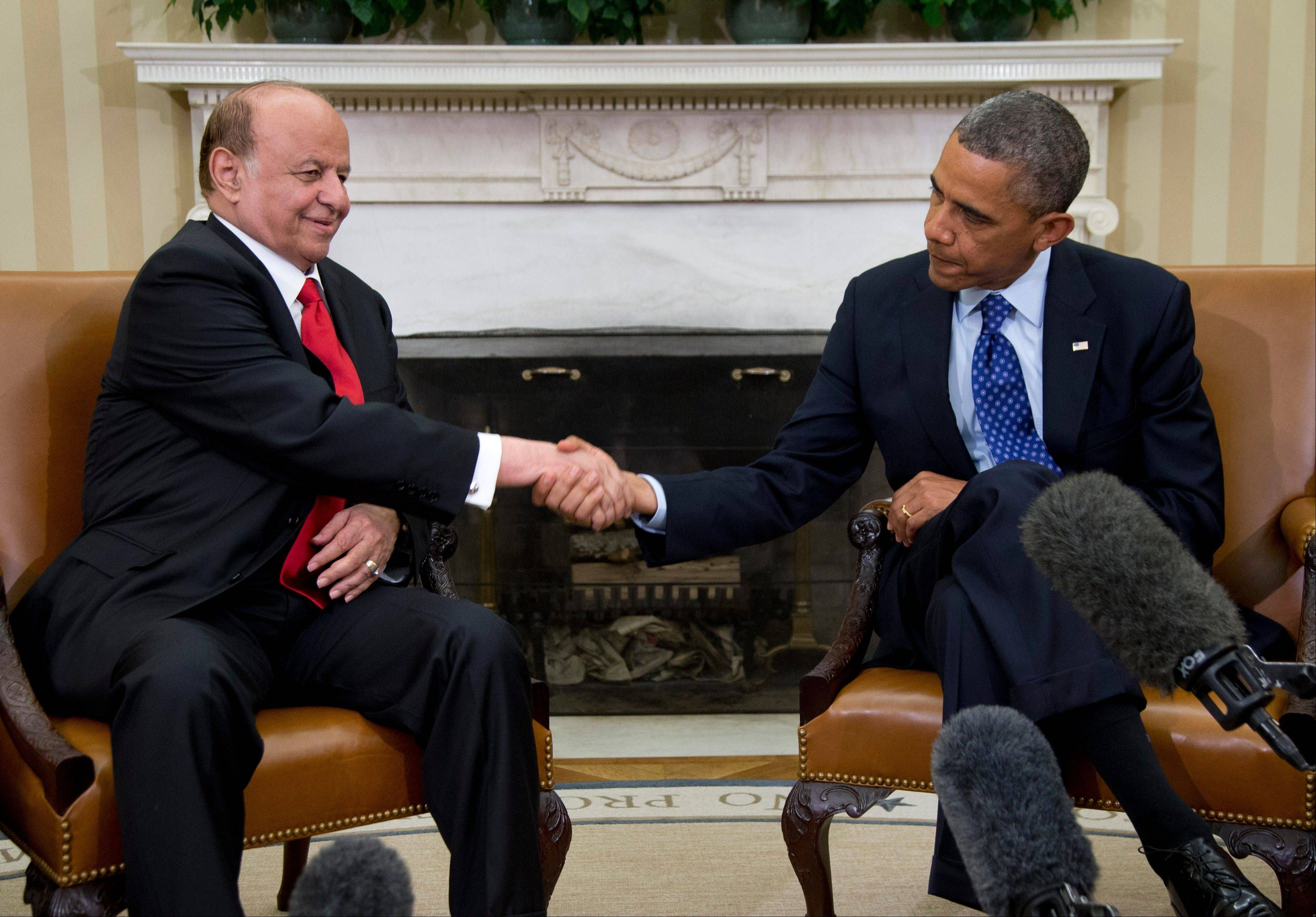 President Barack Obama and Yemen�s president, Abdo Rabby Mansour Hadi shake hands Thursday as they speak to the media in the Oval Office of the White House. On Saturday, the president took a birthday day off and played golf. The White House said there were three golfing foursomes, which included some of Obama�s friends from Hawaii, where he grew up, and Chicago, where he lived before becoming president, as well as current and former aides.