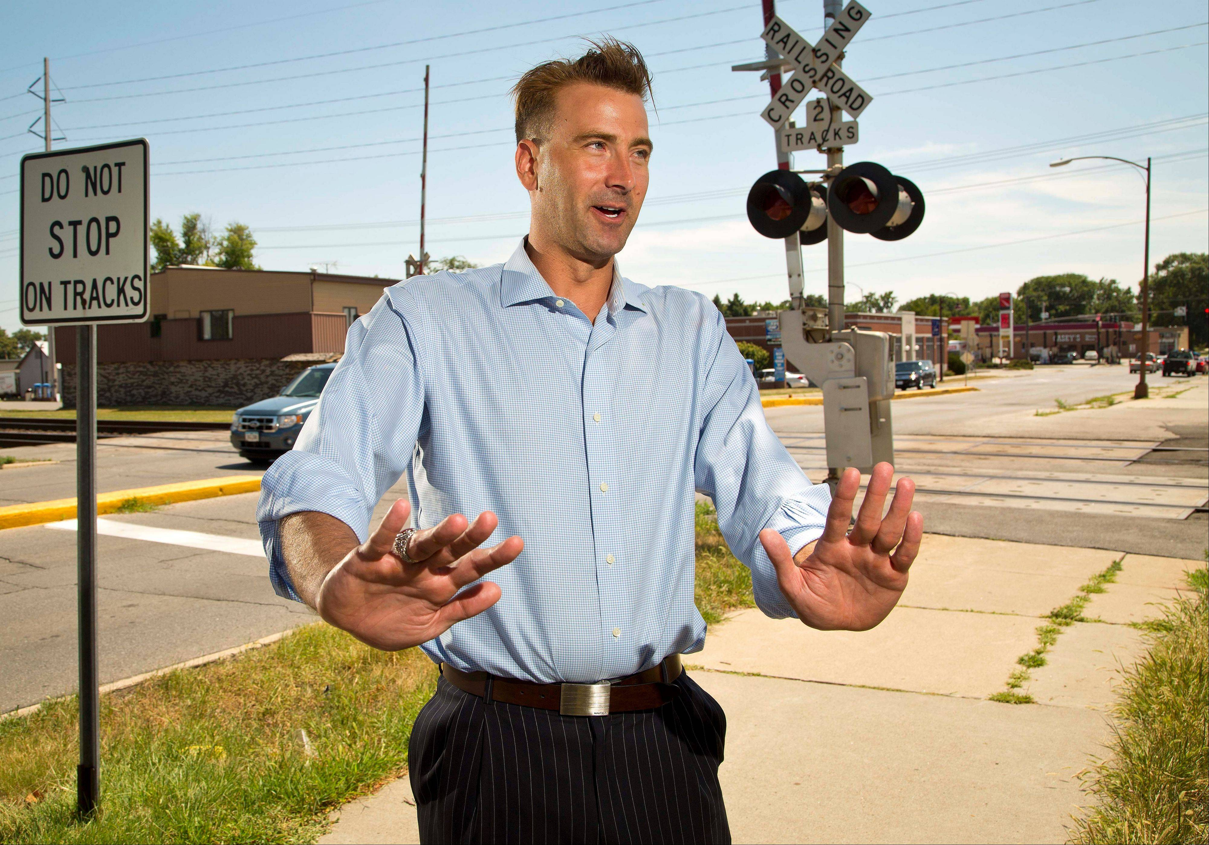 Chris Ihle describes Thursday how he pushed an elderly couple�s car off train tracks in Ames, Iowa.