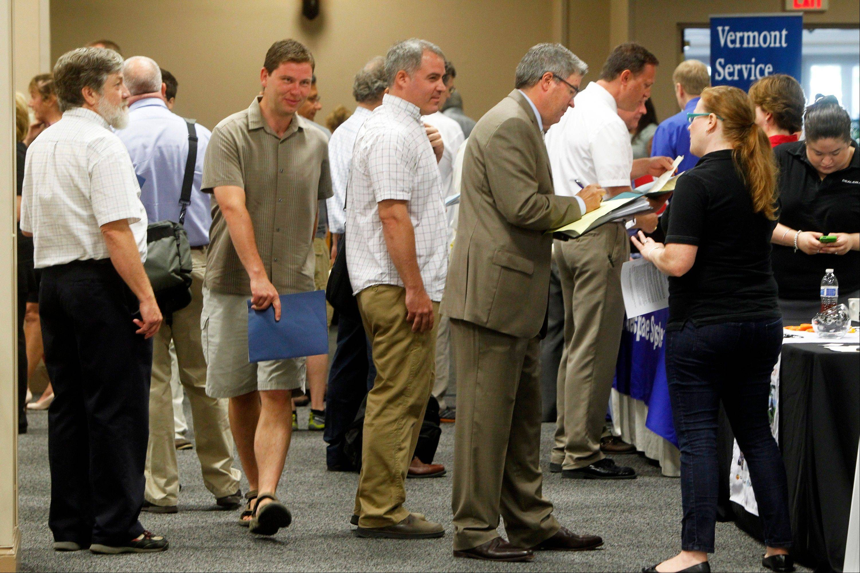 People line up at the job fair in South Burlington, Vt. A disproportionate number of the added jobs in July were part-time or low-paying, or both.