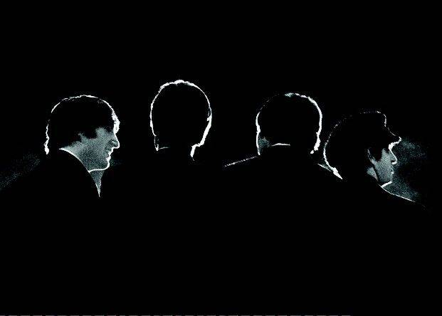 This Feb. 11, 1964 image provided by the David Anthony Fine Art gallery in Taos, N.M., shows a photograph of the Beatles taken by photographer Mike Mitchell during a news conference before the band's first live U.S. concert at the Washington Coliseum.