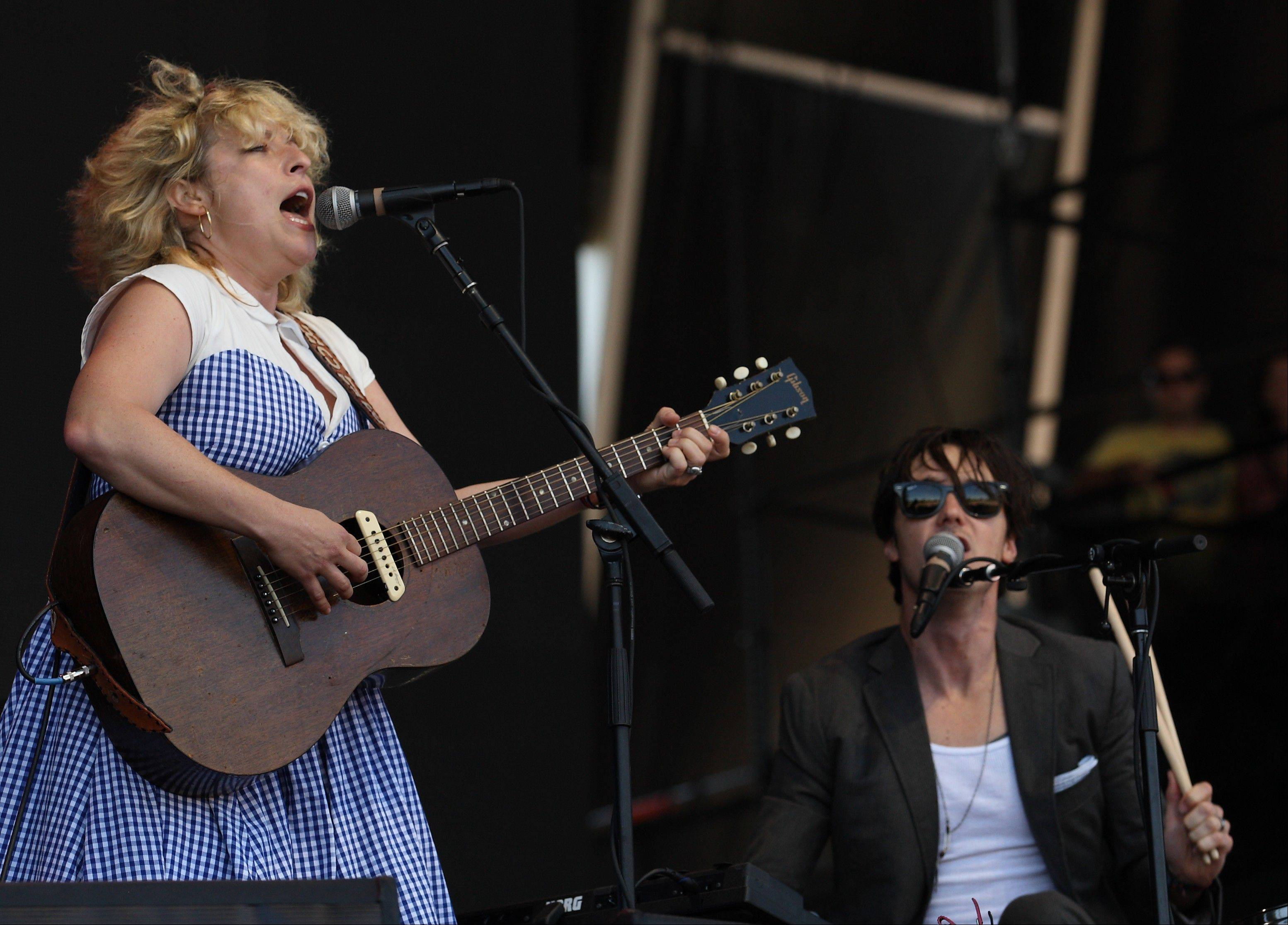 Cary Ann Hearst, left, and Michael Trent, right, of the duo Shovels & Rope on day 2 of Lollapalooza 2013 at Grant Park on Saturday, Aug.3, 2013 in Chicago.
