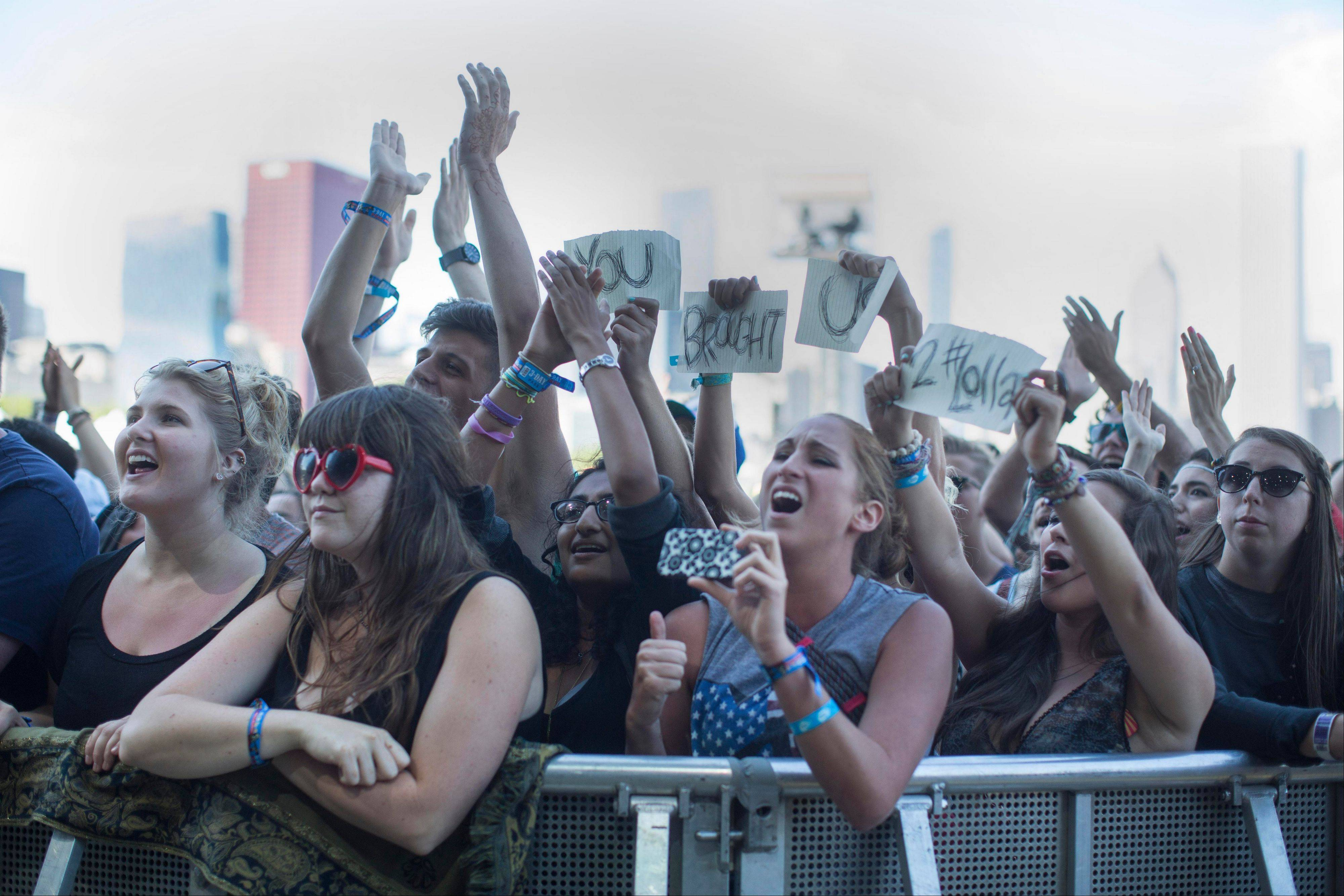 "Ben Howard fans hold up a sign that says ""You Brought Us To Lollapalooza"" during his performance at the Red Bull Stage at the Lollapalooza Festival in Chicago, Saturday, Aug. 3, 2013. The more than two-decade-old festival opened Friday in Chicago's lakefront Grant Park."