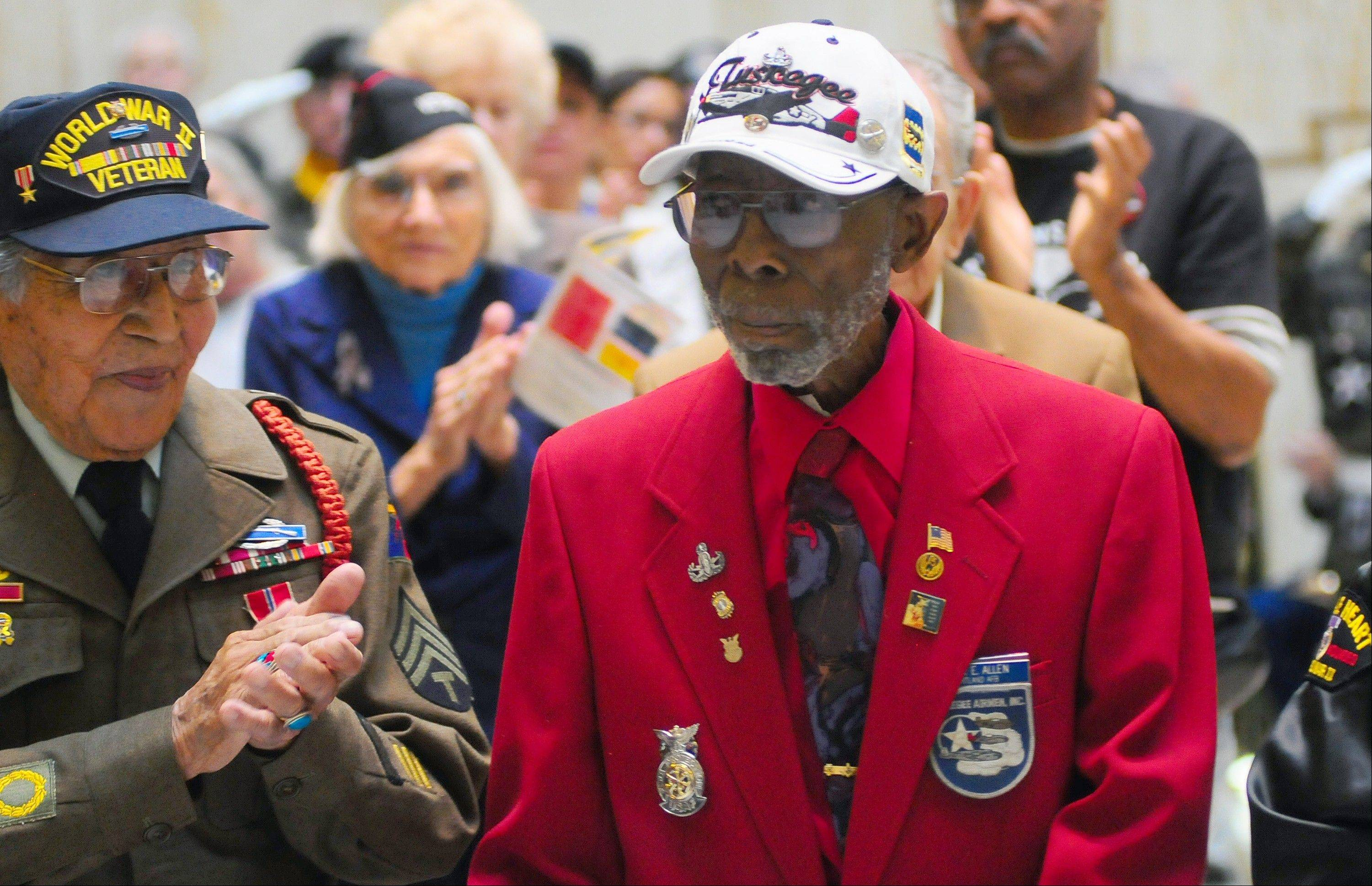 Tuskegee Airman John Allen, right, of Rio Rancho, N.M. is applauded by World War II veteran Tom Dailey at the Capitol Rotunda in Santa Fe, N.M, last February.