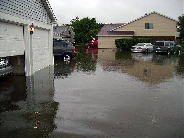 Roads, garages and many condos flooded in the Hearthwood Farms subdivision in Bartlett in September 2008. Village officials announced Friday that a U.S. grant of $3.8 million will help pay for flood prevention measures.