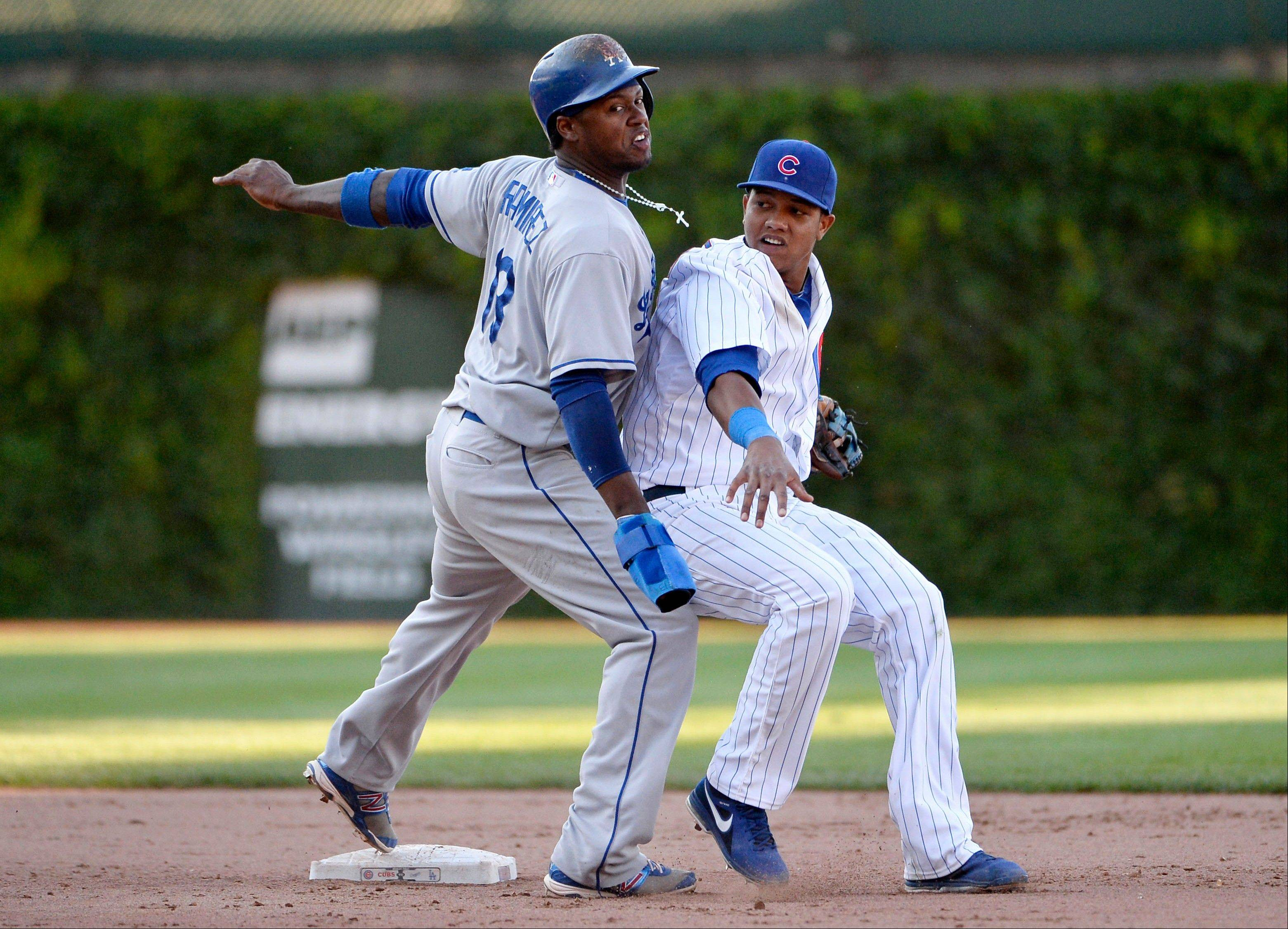 Los Angeles Dodgers' Hanley Ramirez, left, collides with Chicago Cubs shortstop Starlin Castro after Castro doubled him up at second base after catching a line drive hit by Adrian Gonzalez during the ninth inning of a baseball game, Saturday, Aug. 3, 2013, in Chicago.