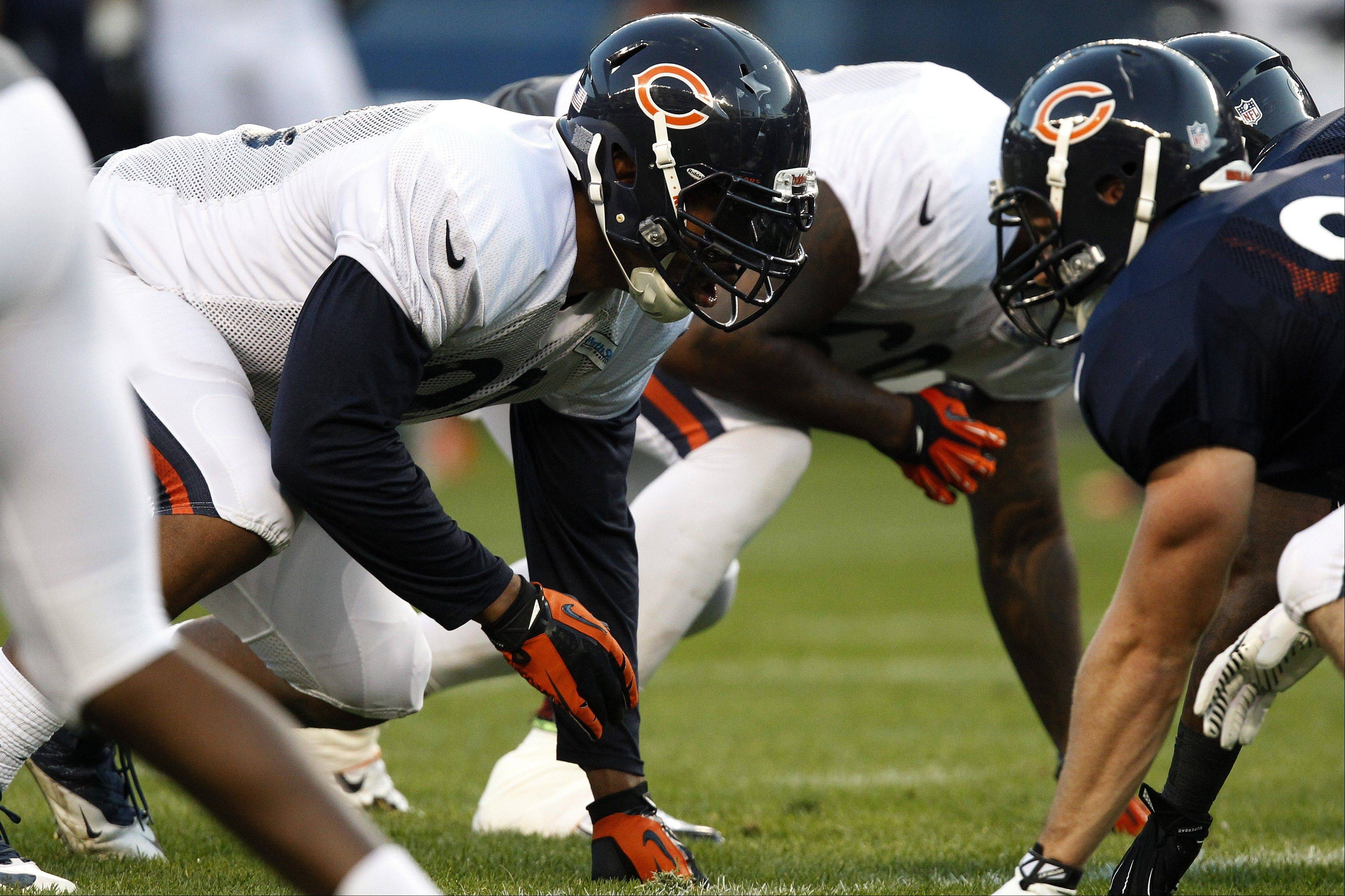 Chicago Bears defensive end Julius Peppers gets into position for a drill during NFL football training camp at Soldier Field in Chicago, Saturday Aug. 3, 2013.