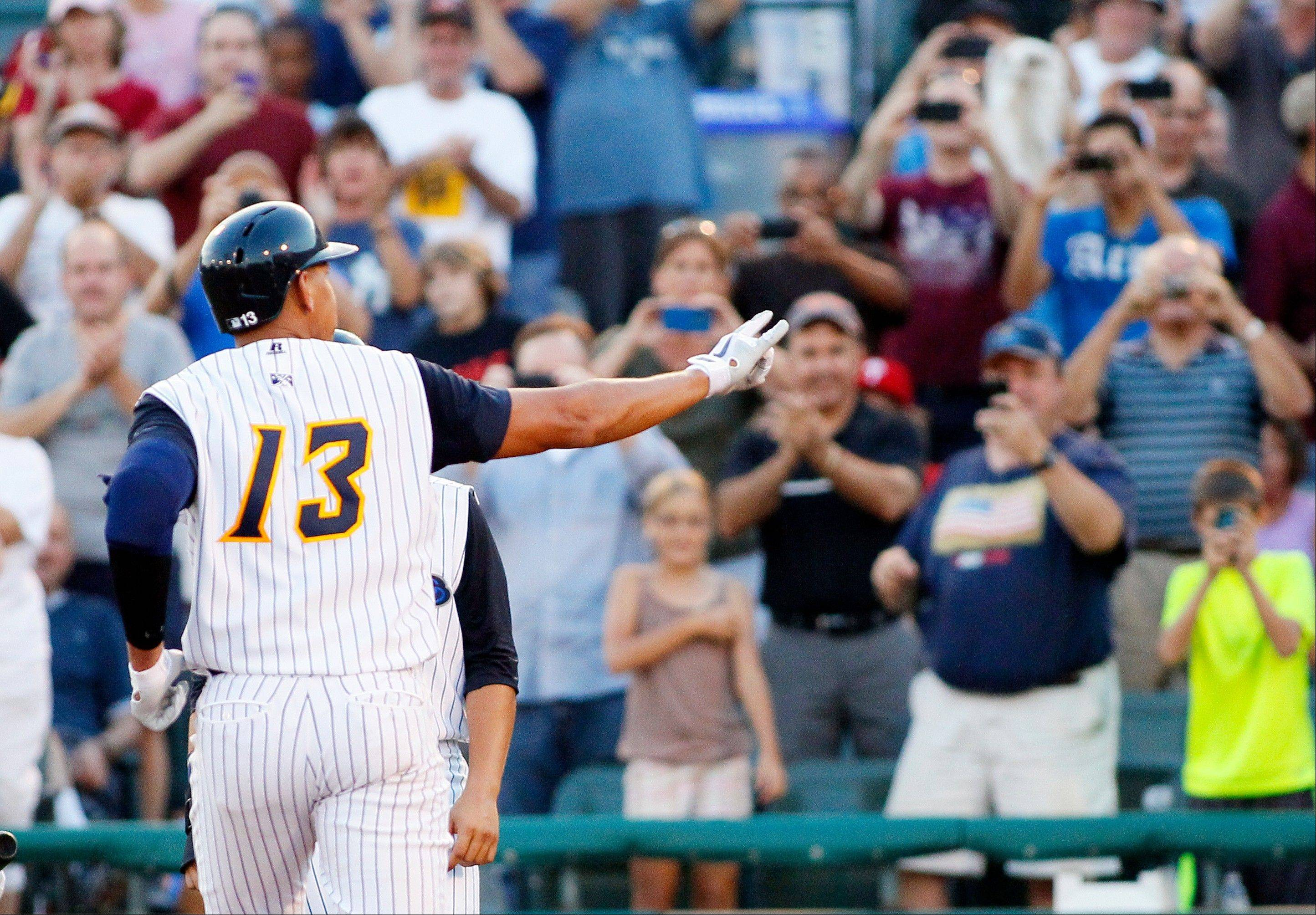 New York Yankees' Alex Rodriguez gestures to the fans as he crosses home plate after hitting a solo home run during the third inning of a Class AA baseball game with the Trenton Thunder against the Reading Phillies, Friday, Aug. 2, 2013, in Trenton, N.J.