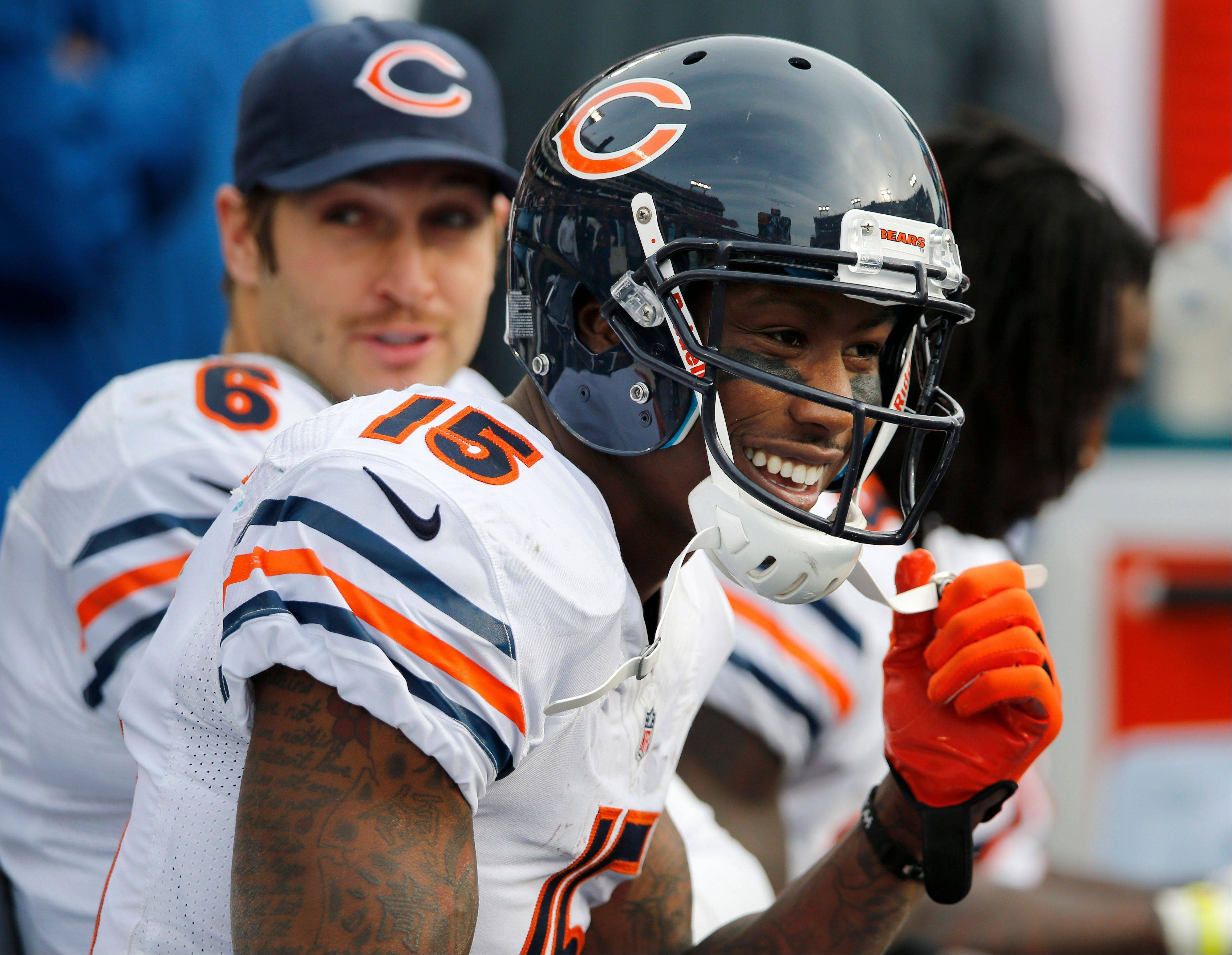 Chicago Bears wide receiver Brandon Marshall (15) and quarterback Jay Cutler (6)take a break on the bench after Cutler threw a touchdown pass to Marshall against the Tennessee Titans in the fourth quarter of an NFL football game on Sunday, Nov. 4, 2012, in Nashville, Tenn. Marshall caught three touchdown passes from Cutler as the Bears beat the Titans 51-20.