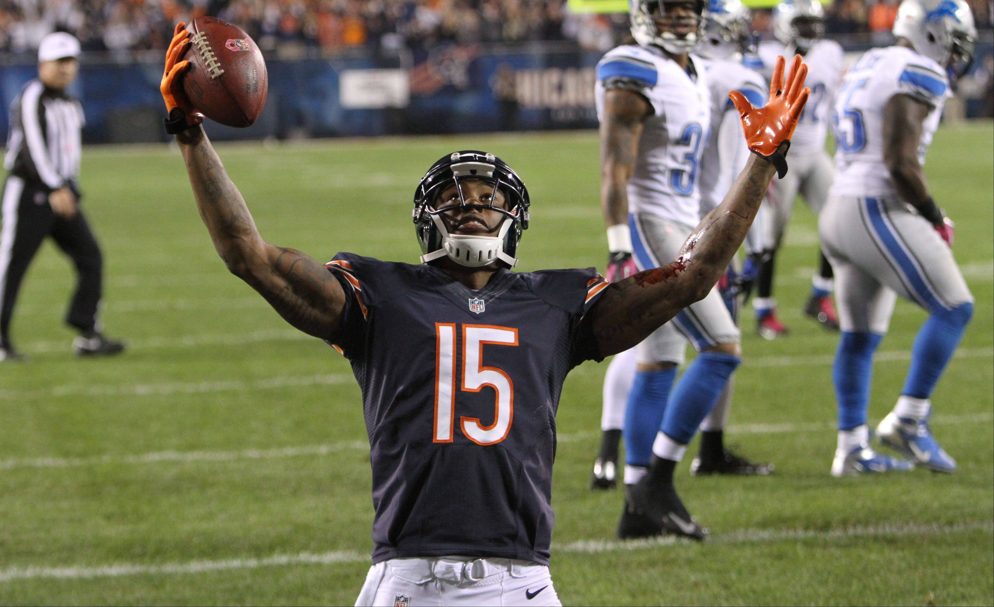 Steve Lundy/slundy@dailyherald.com � Chicago Bears wide receiver Brandon Marshall celebrates his first quarter touchdown during their game against the Detroit Lions Monday night at Soldier Field in Chicago.