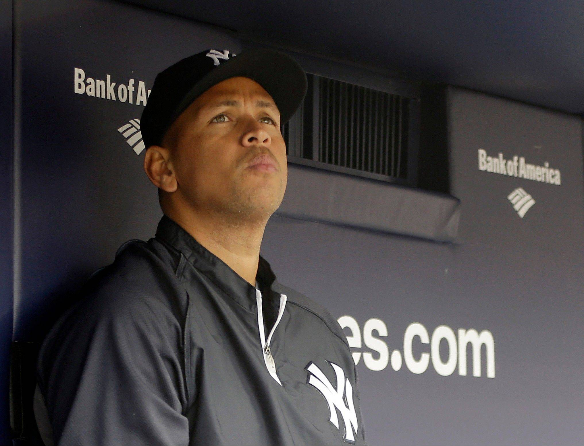 FILE - This April 13, 2013, file photo shows New York Yankees' Alex Rodriguez sitting in the dugout during a baseball game at Yankee Stadium in New York. Three MVP awards, 14 All-Star selections, two record-setting contracts and countless controversies later, A-Rod is the biggest and wealthiest target of an investigation into performance-enhancing drugs, with a decision from baseball Commissioner Bud Selig expected on Monday, Aug. 5, 2013.
