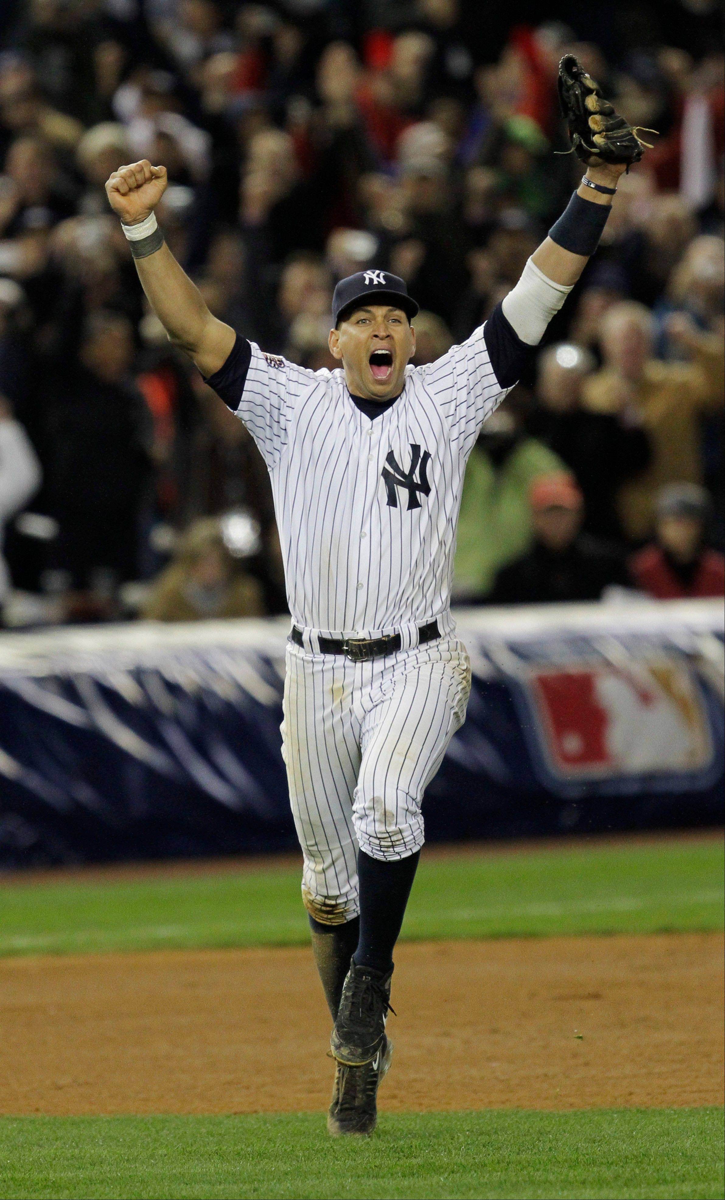 FILE - In this Nov. 4, 2009, file photo, New York Yankees' Alex Rodriguez celebrates after winning the Major League Baseball World Series against the Philadelphia Phillies in New York. Three MVP awards, 14 All-Star selections, two record-setting contracts and countless controversies later, A-Rod is the biggest and wealthiest target of an investigation into performance-enhancing drugs, with a decision from baseball Commissioner Bud Selig expected on Monday, Aug. 5, 2013.