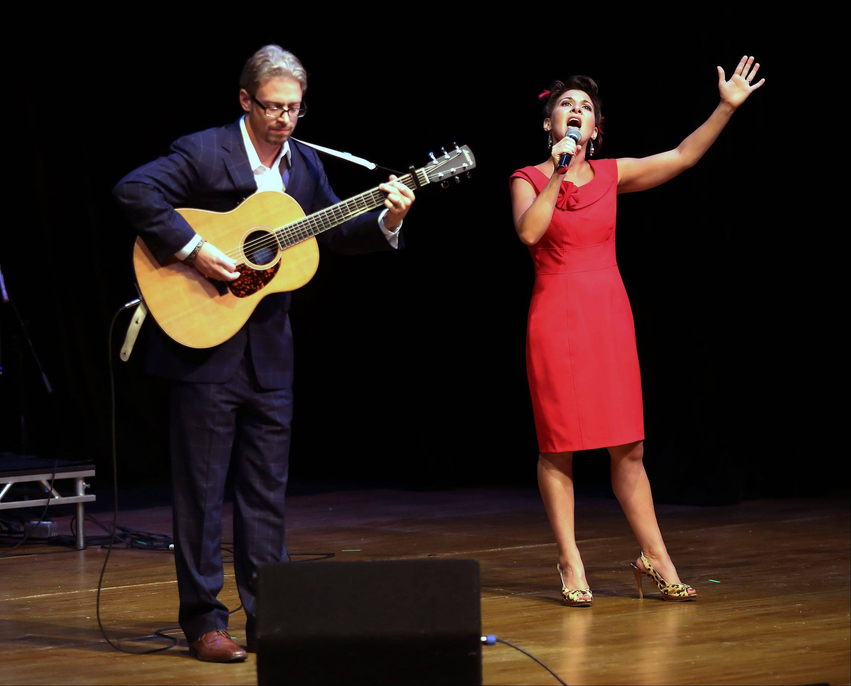 "Sean and Karen Slavin of Woodstock sing ""Over the Rainbow"" during Suburban Chicago's Got Talent competition at the Metropolis Performing Arts Centre in Arlington Heights. They will be competing against the other nine finalists on Sunday, Aug. 4."