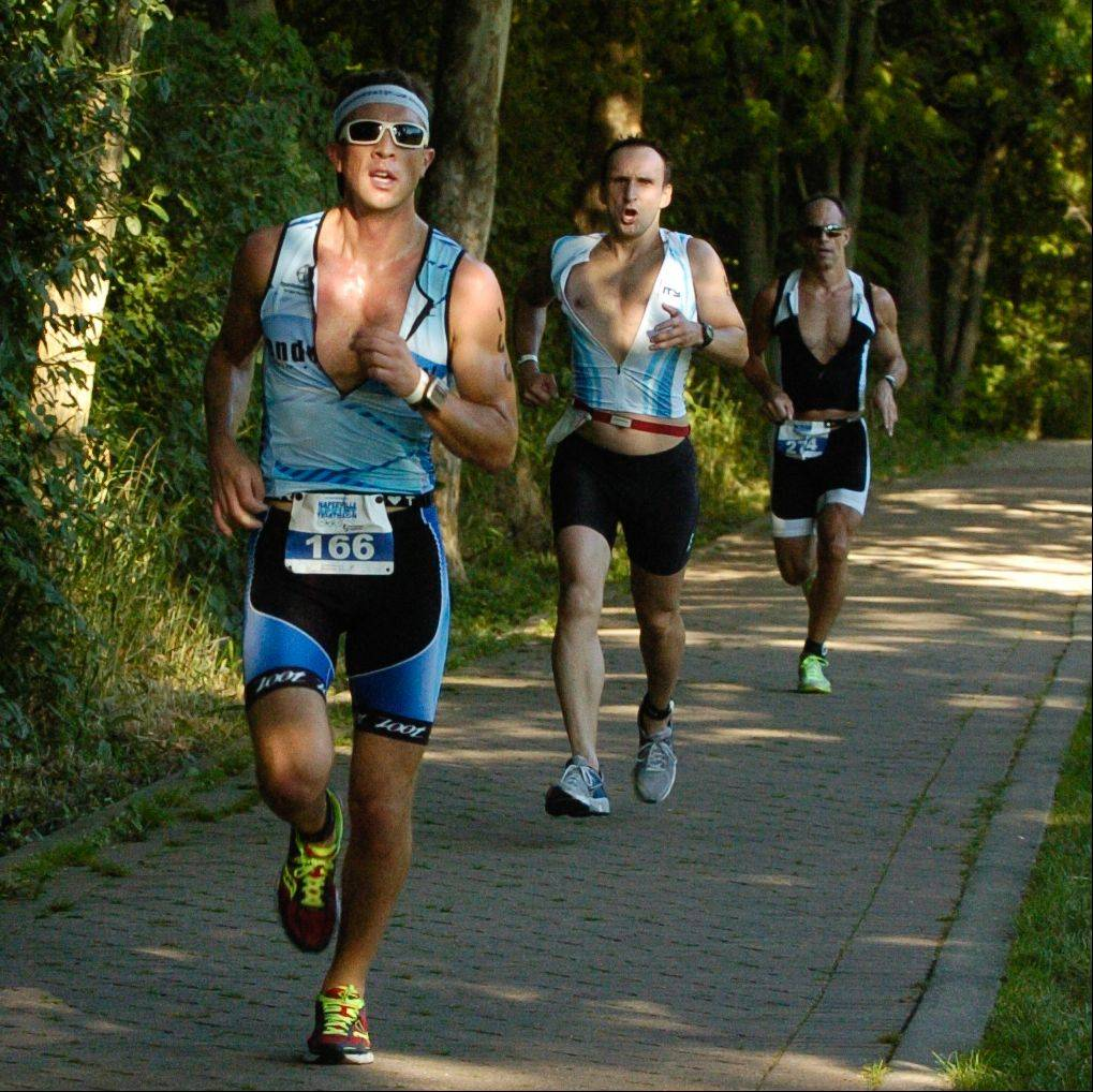 Triathletes run the final portion of the 5K course during Sunday's Naperville Sprint Triathlon.
