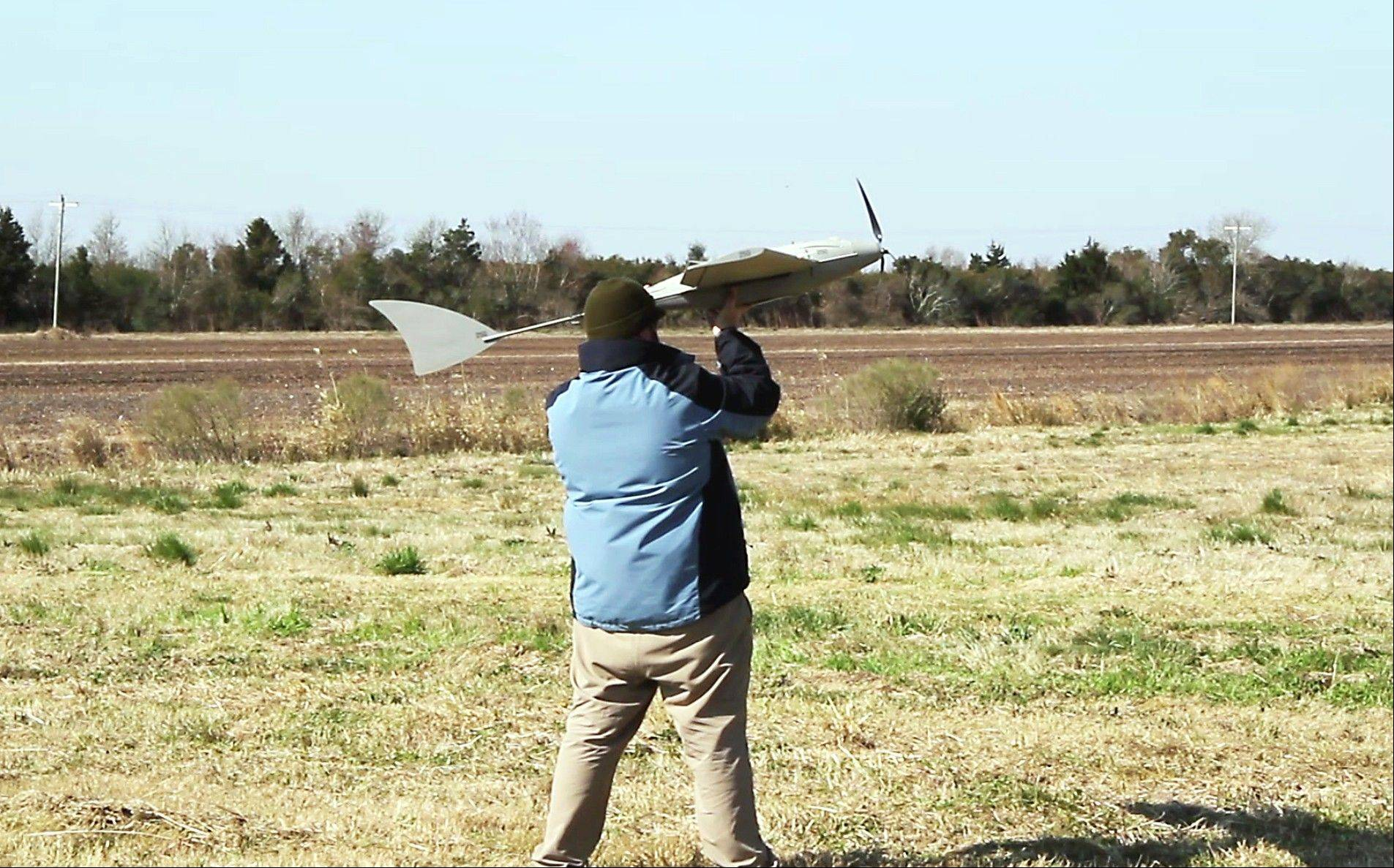 In this March 21, 2013, photo provided by the North Carolina Department of Transportation, a technician from BOSH Technologies prepares to launch a remotely piloted aircraft during the first test flight at Hyde County Airport in Engelhard, N.C. A little-noted provision in North Carolina's budget bans police and other government agencies to buy surveillance drones for the next two years as state lawmakers study the balance between security and privacy. Varied legislation involving drones was introduced this year in more than 40 states