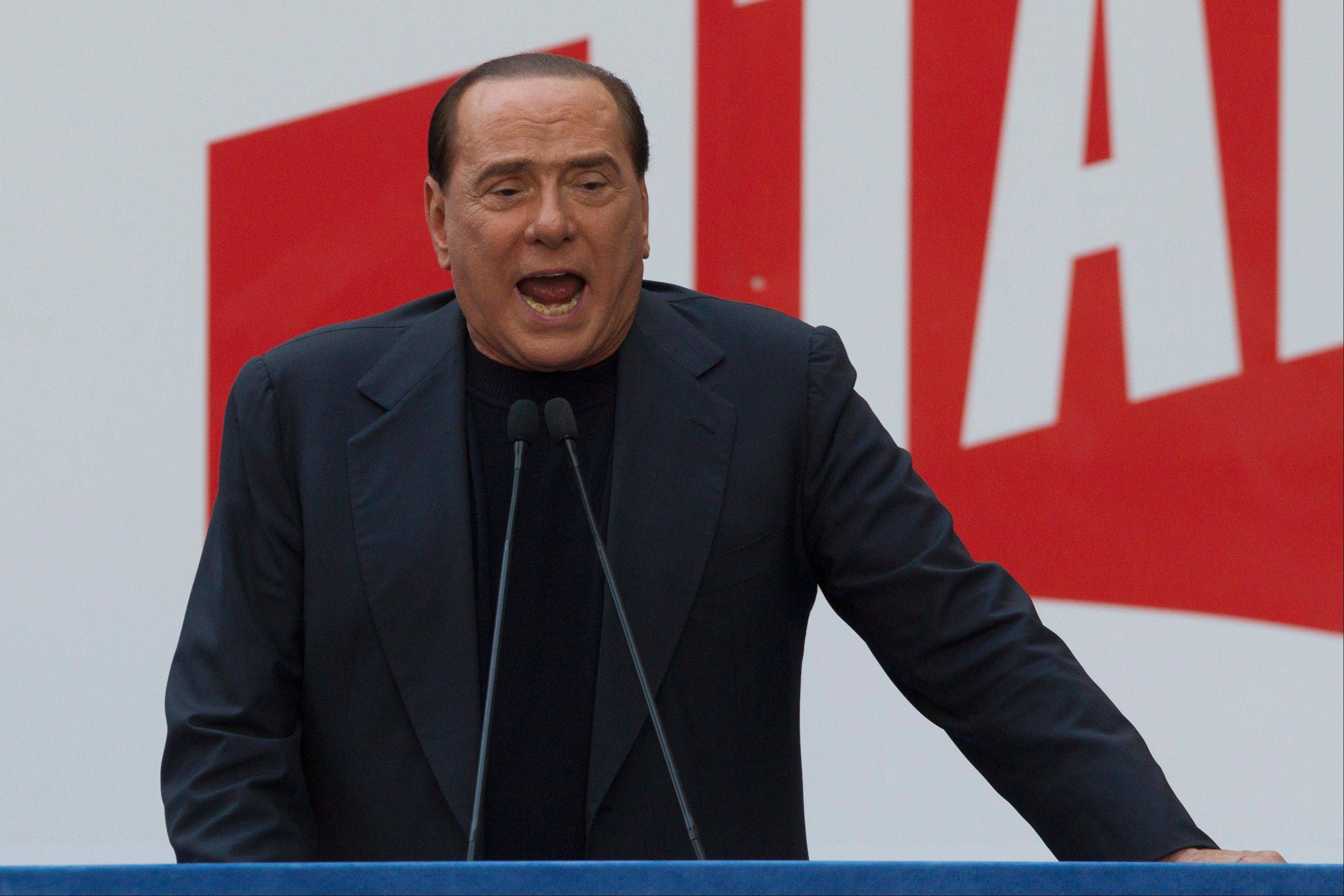 Silvio Berlusconi talks to his supporters Sunday during a demonstration in front of his residence in Rome.