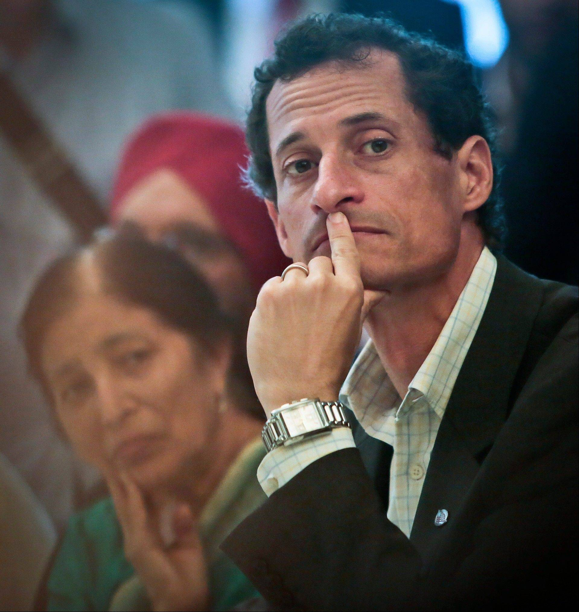 New York mayoral candidate Anthony Weiner, center, listens during a meeting \Friday with leaders from the South and East Asian communities in Queens.