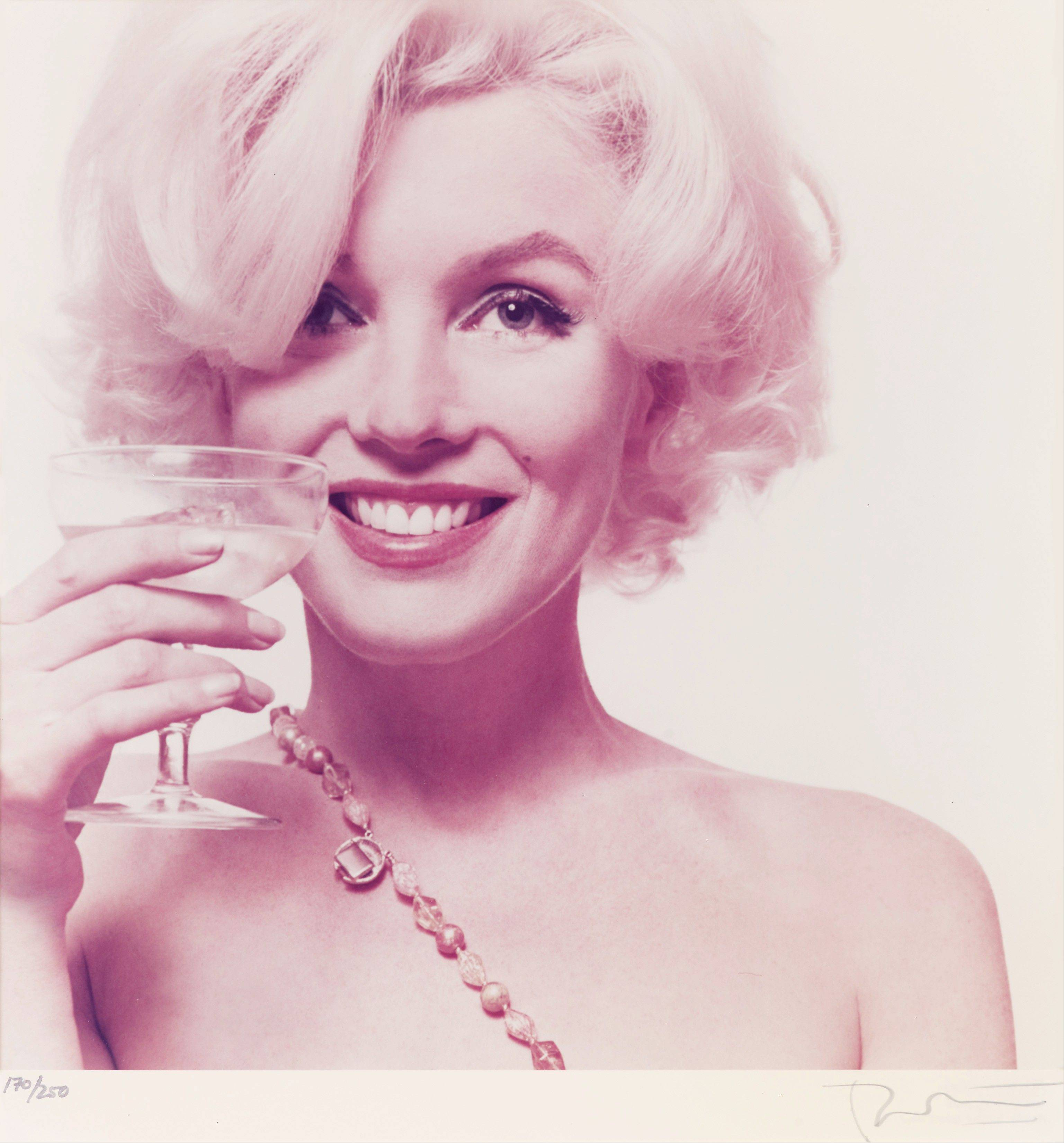 This 1962 photo provided by Freeman�s auction house in Philadelphia shows one of a limited-edition portfolio of 10 photos of Marilyn Monroe that is scheduled to go on the block Sept. 10.