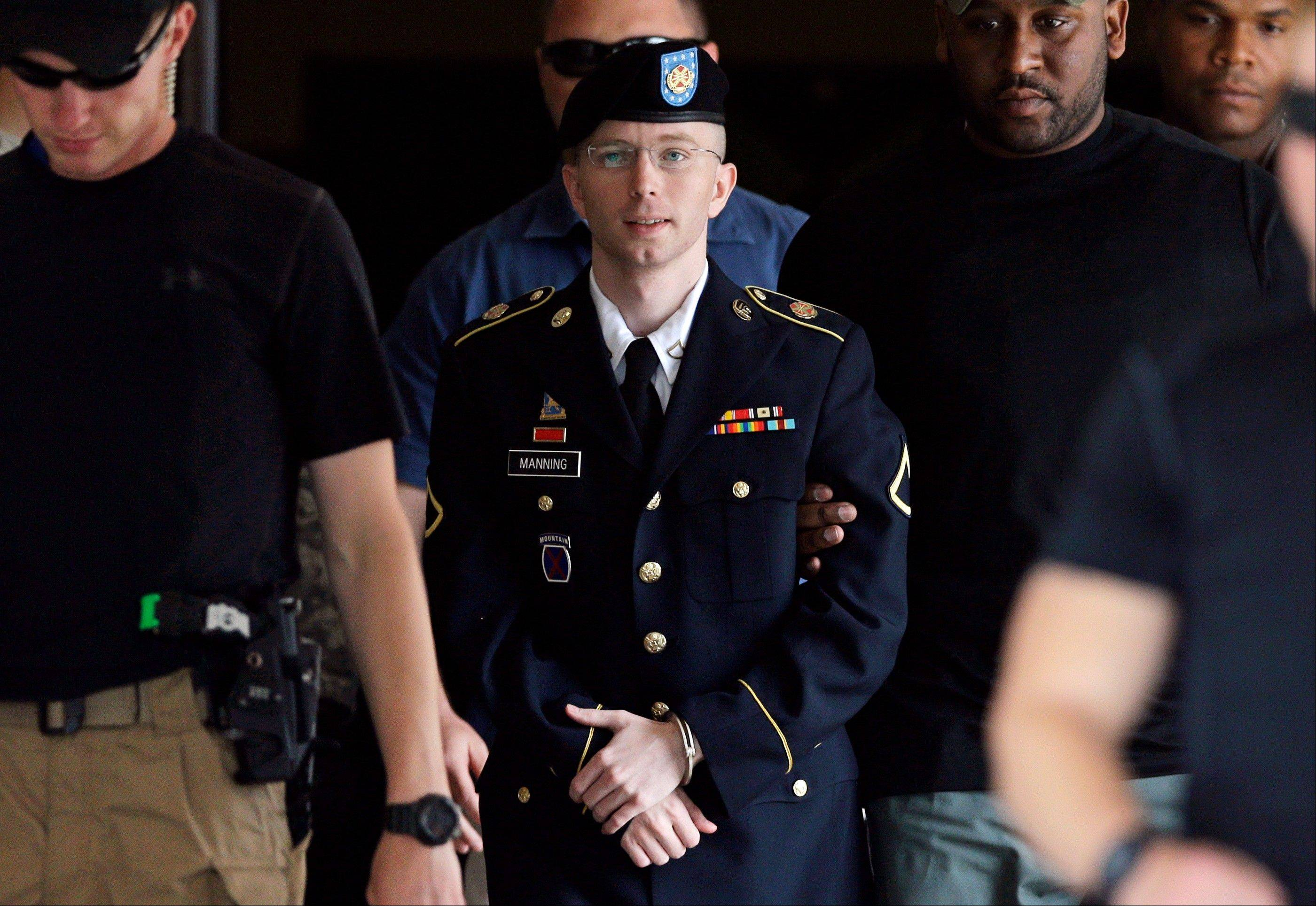 Soldier Bradley Manning is escorted out of a courthouse on July 30 in Fort Meade, Md.