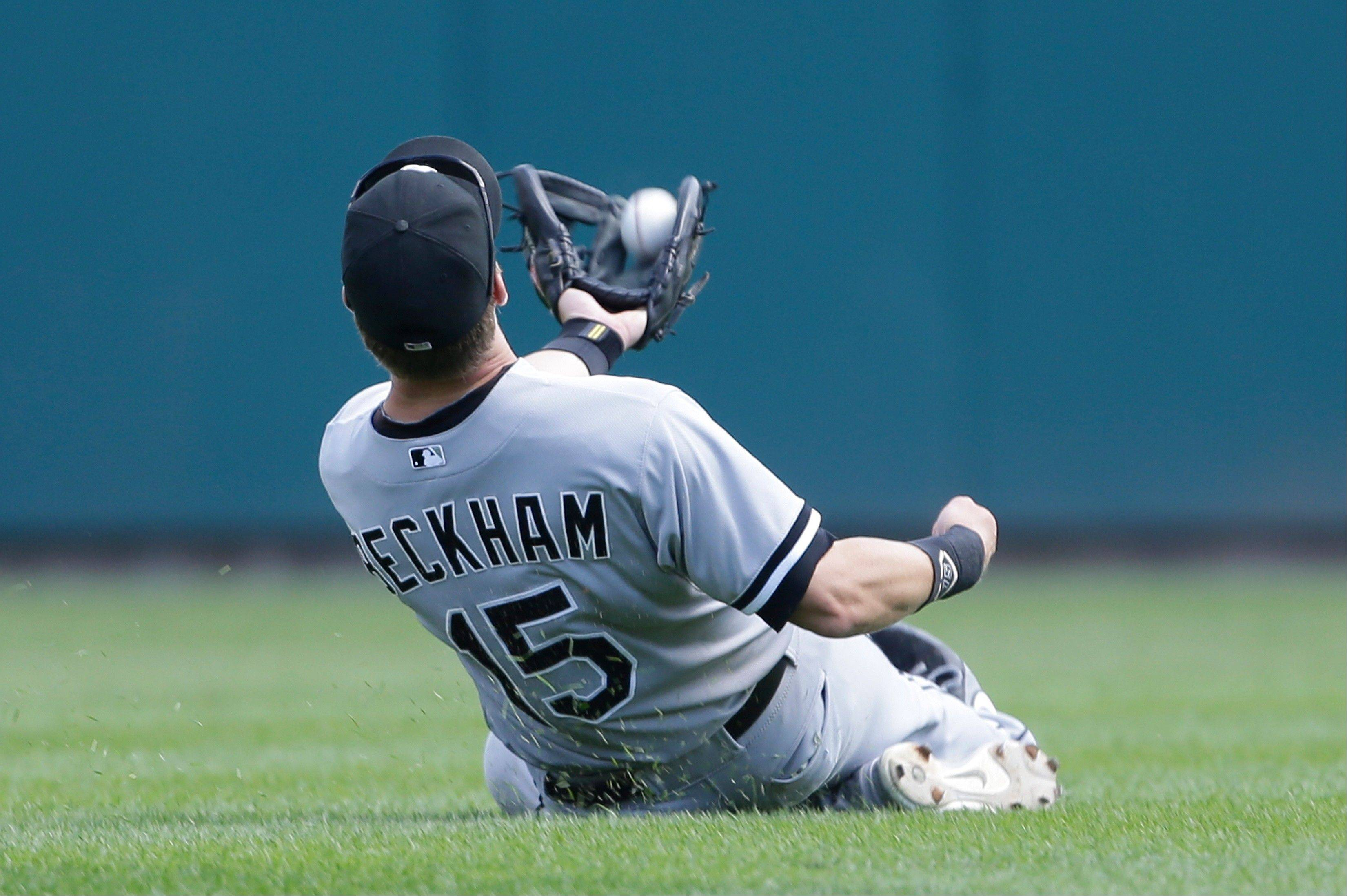White Sox second baseman Gordon Beckham makes a sliding, over-the-shoulder catch of a Prince Fielder popup in the eighth inning of Sunday�s loss to the Tigers.