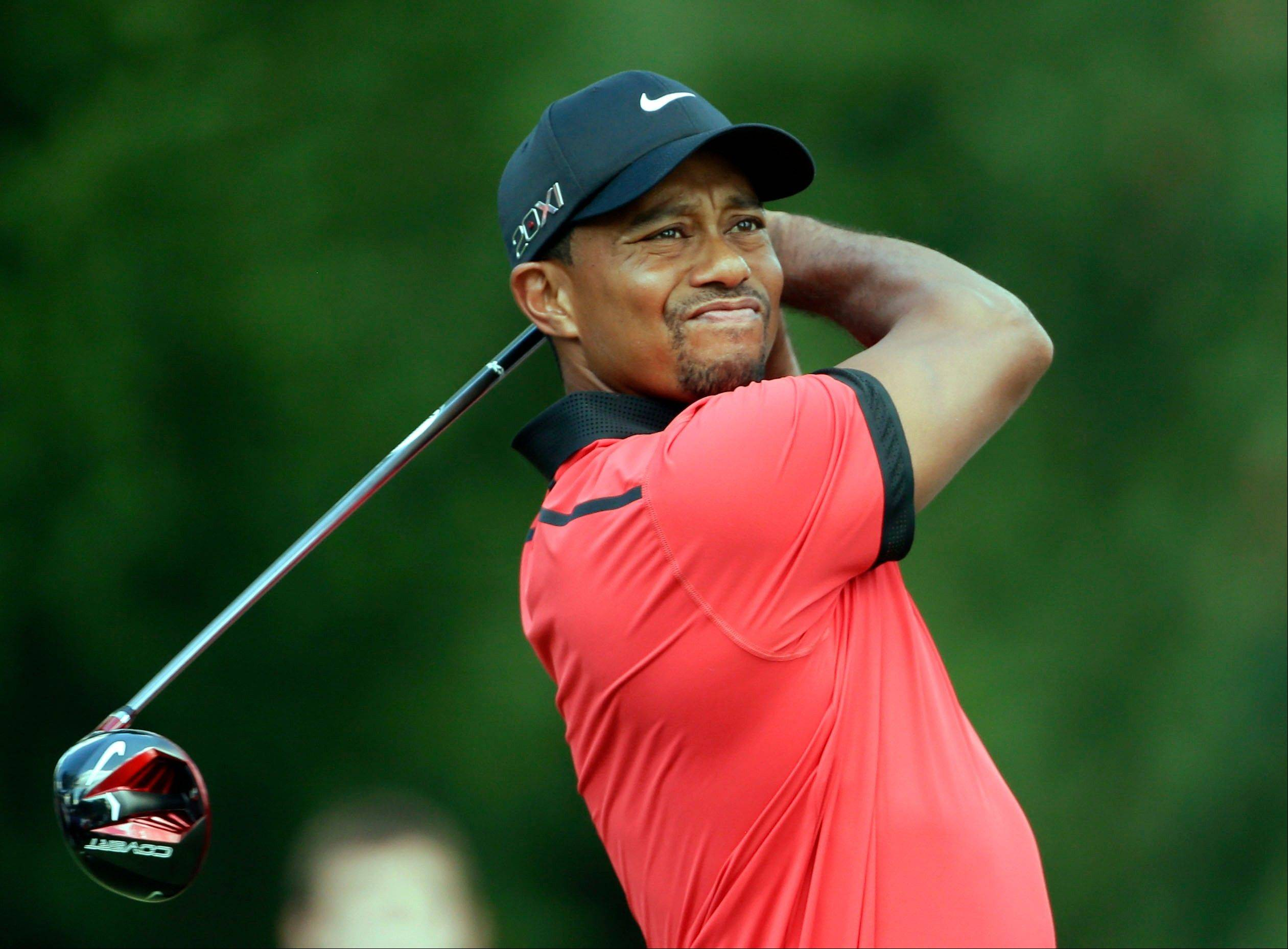 Tiger Woods watches his tee shot on the fourth hole during the Sunday's round of the Bridgestone Invitational at Firestone Country Club in Akron, Ohio.