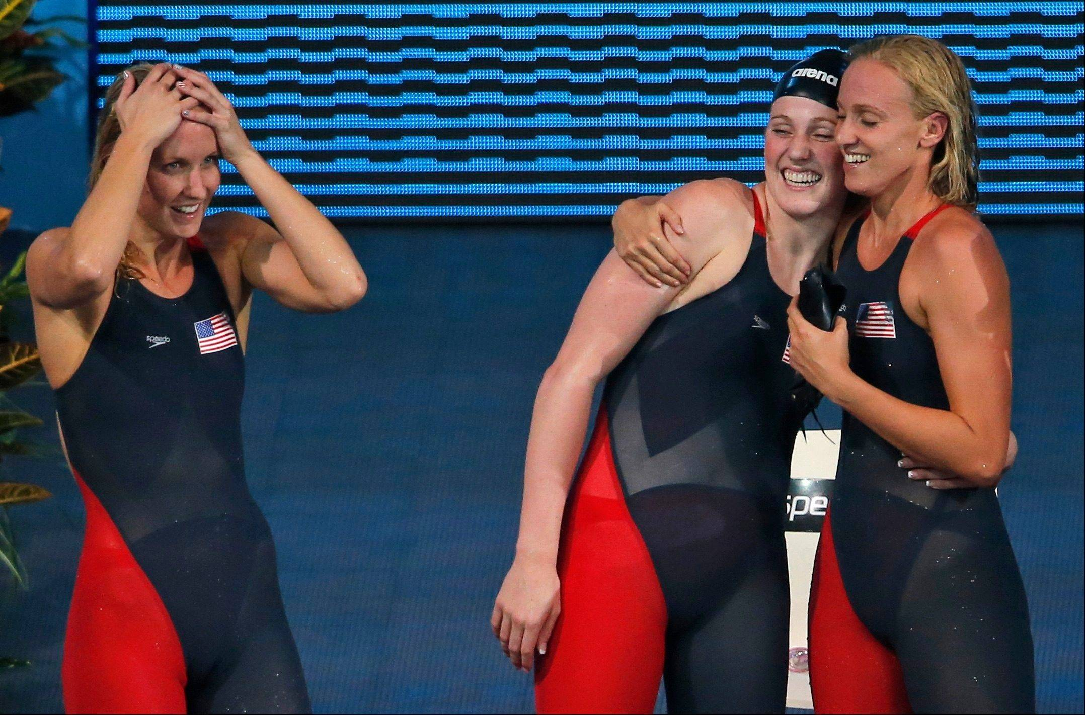 The U.S. women's 4x100 medley relay team, from left, Jessica Hardy, Missy Franklin and Dana Vollmer celebrate after Megan Romano, not in the photo. anchored them to the gold medal Sunday at the FINA Swimming World Championships in Barcelona, Spain.