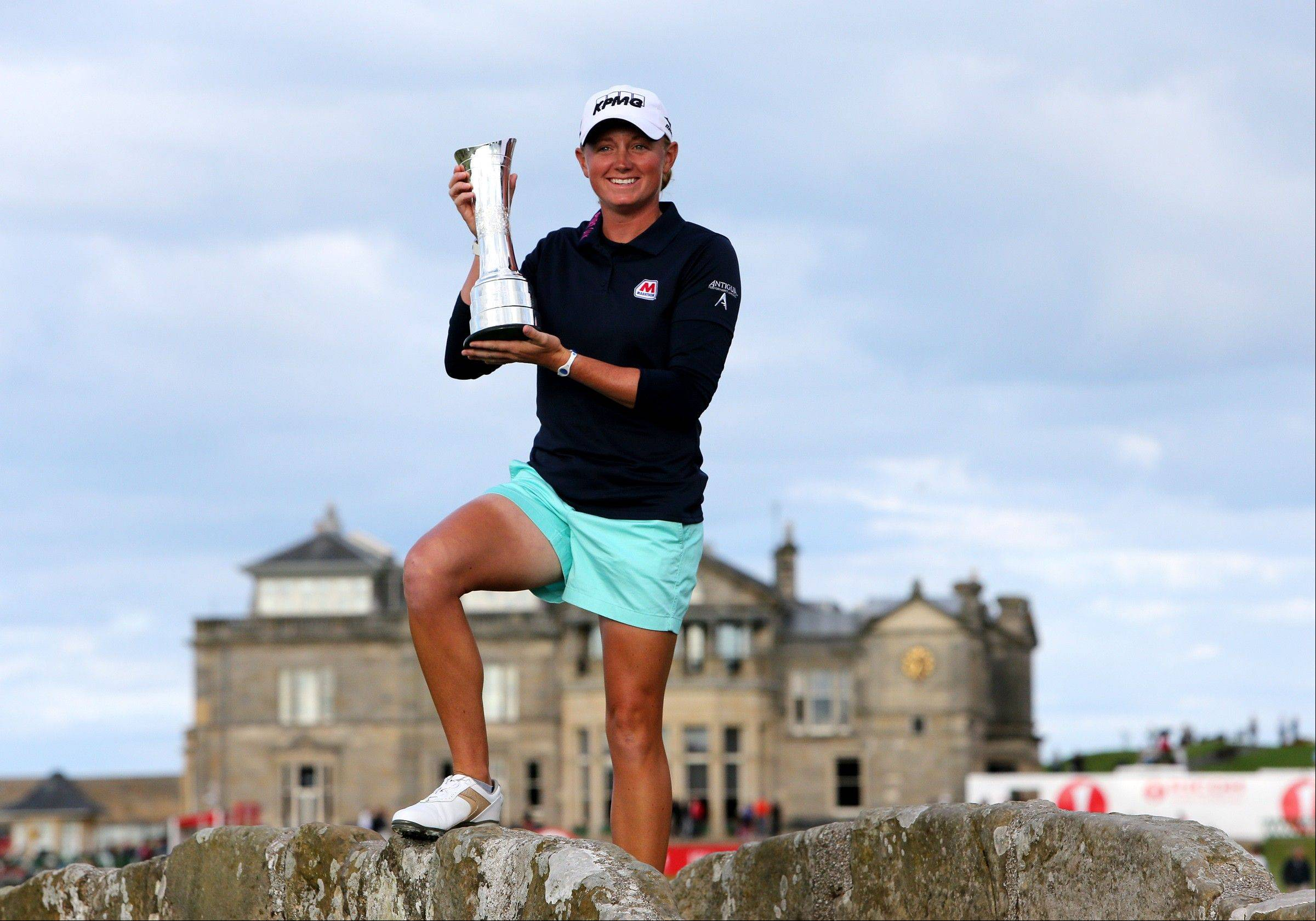 American Stacy Lewis poses with the trophy after winning the Women�s British Open golf championship Sunday on the Old Course at St Andrews, Scotland.