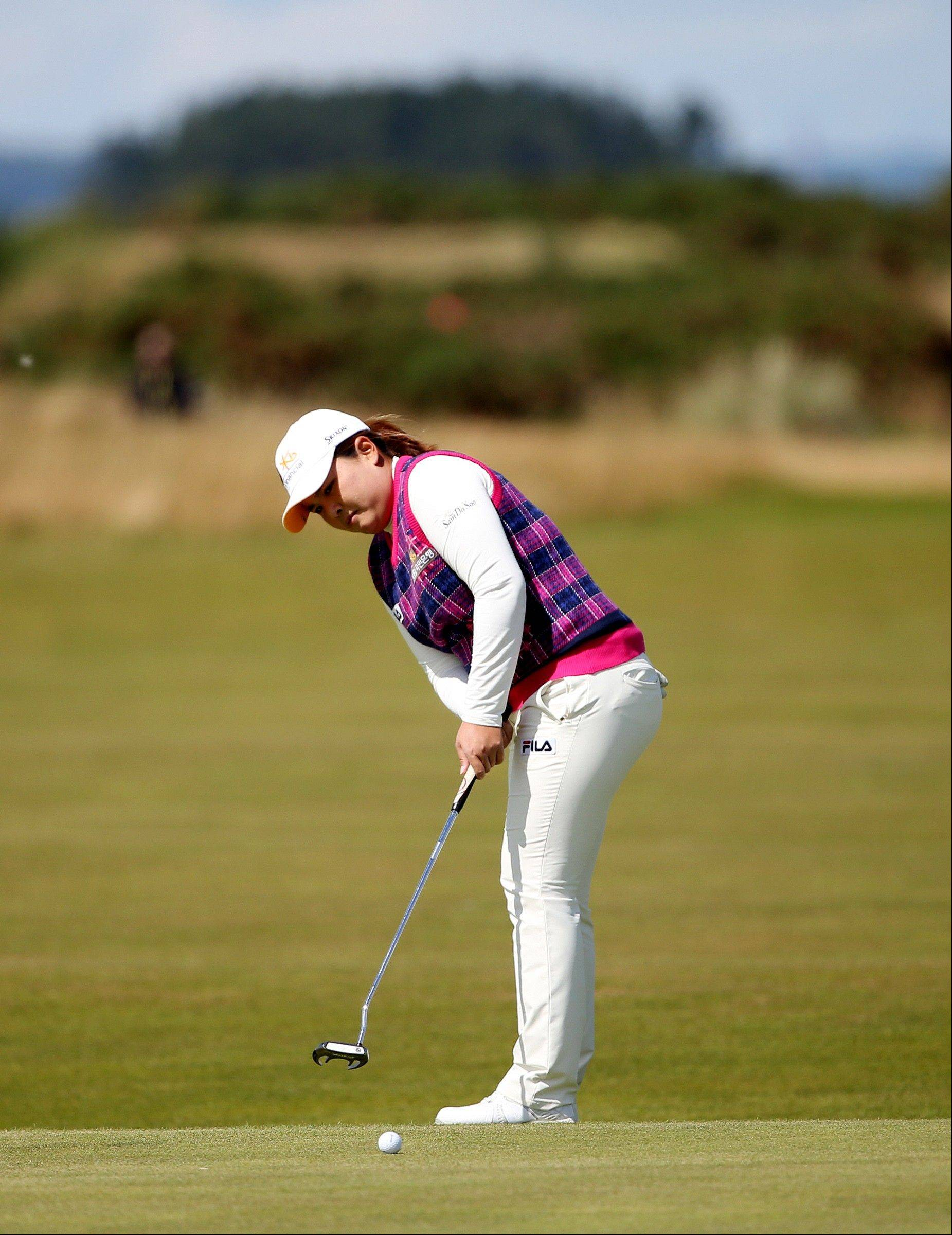 South Korea�s Inbee Park putts on the 9th green during the fourth round of the Women�s British Open golf championship Sunday on the Old Course at St Andrews, Scotland.