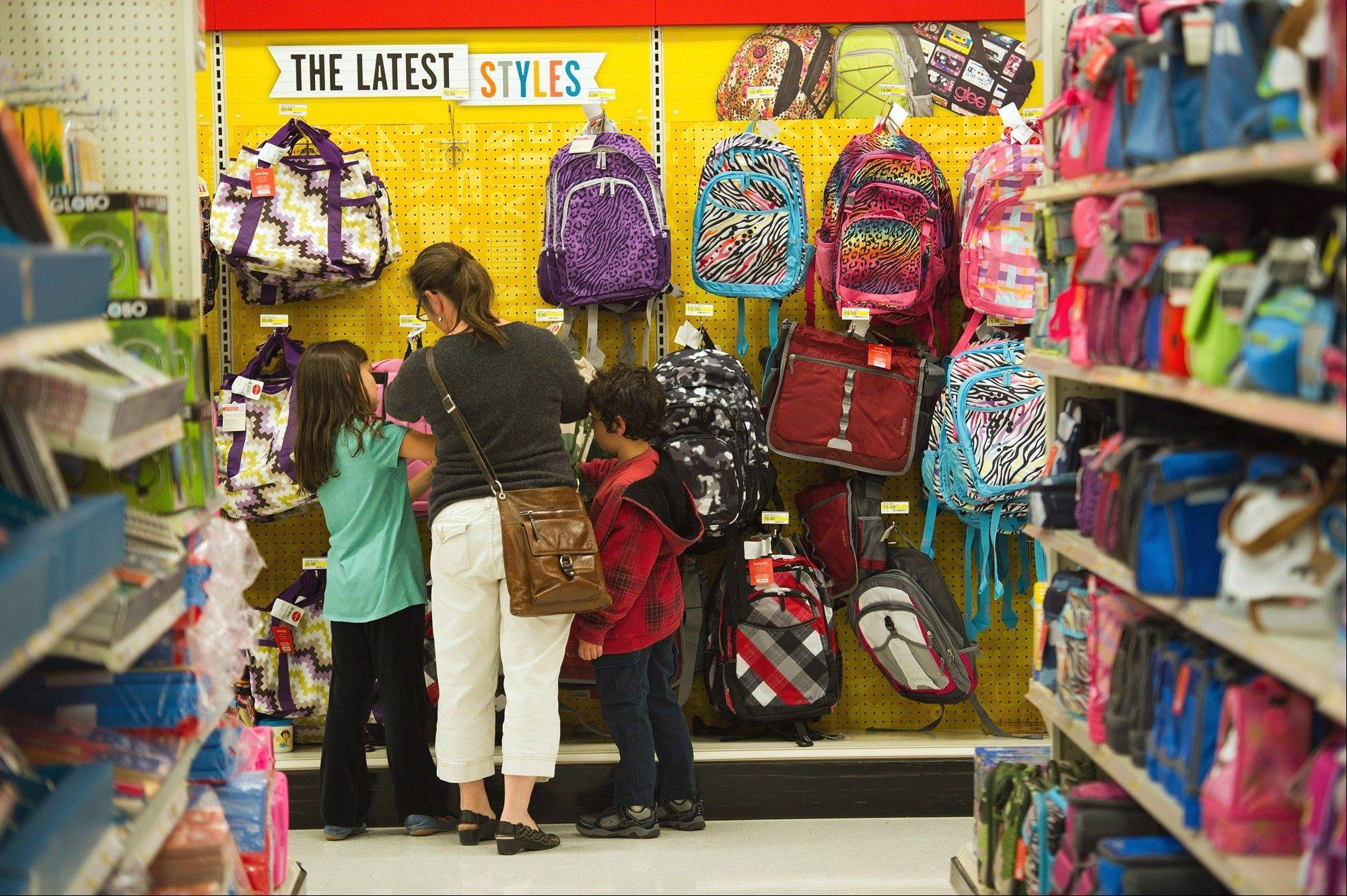 U.S. households plan to spend an average 7.8 percent less for this year's back-to-school shopping season because of the bumpy economic recovery, the National Retail Federation says.