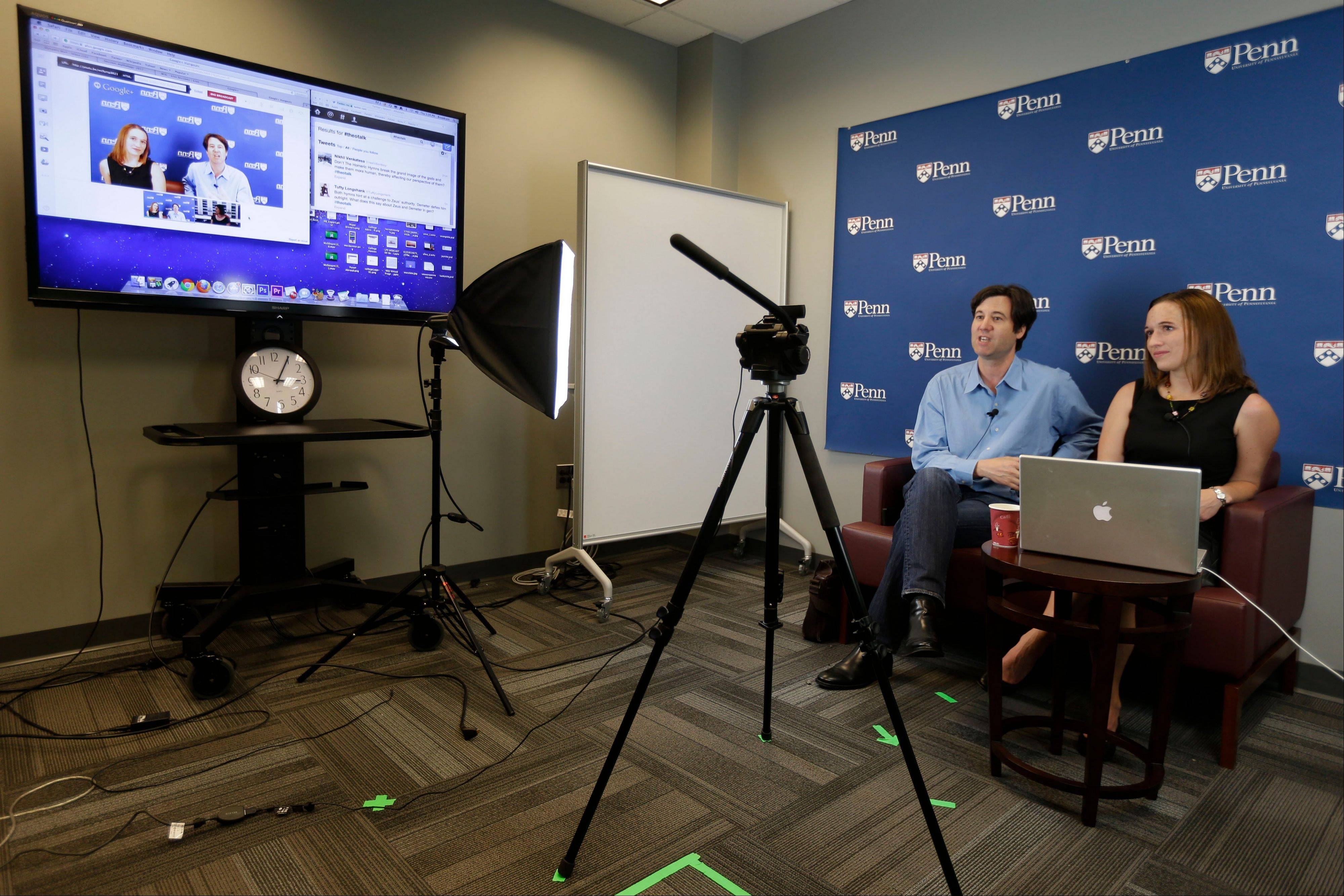 University of Pennsylvania professor Peter Struck, accompanied by teaching assistant Cat Gillespie, teaches a mythology class during a live recording of a massive, open, online classes (MOOC), in Philadelphia. Recent financial pressures and new technologies are opening cracks in traditional, age-old structures of higher education. Terms like 'credit hour' and even the definition of what it means to be a college are in flux. Higher education is becoming 'unbundled.' Individual classes and degrees are losing their connections to single institutions, in much the same way iTunes has unbundled songs from whole albums, and the Internet is increasingly unbundling television shows and networks from bulky cable packages.
