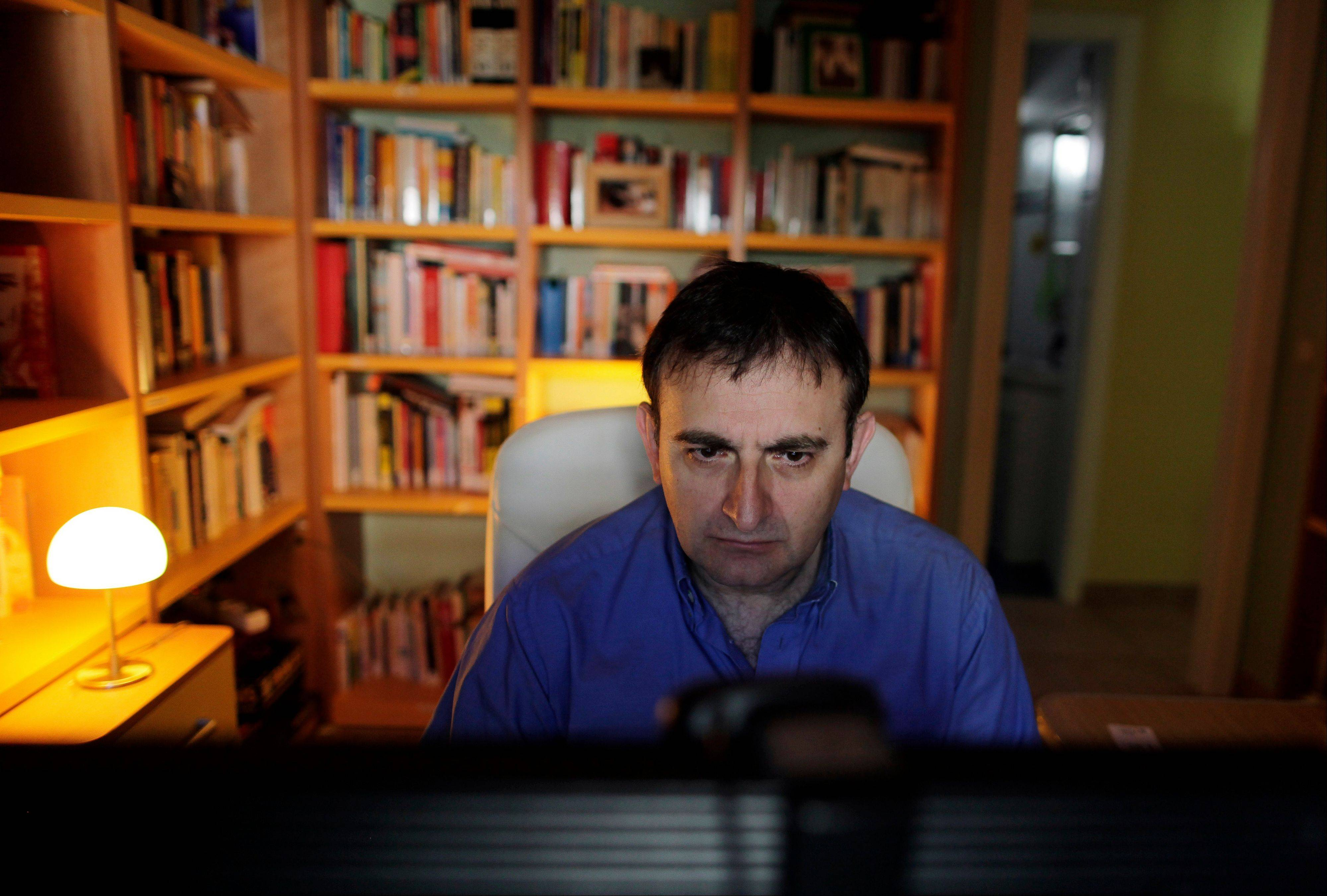 Raul Ramos goes through his online homework during a session of a massive online class in Madrid.