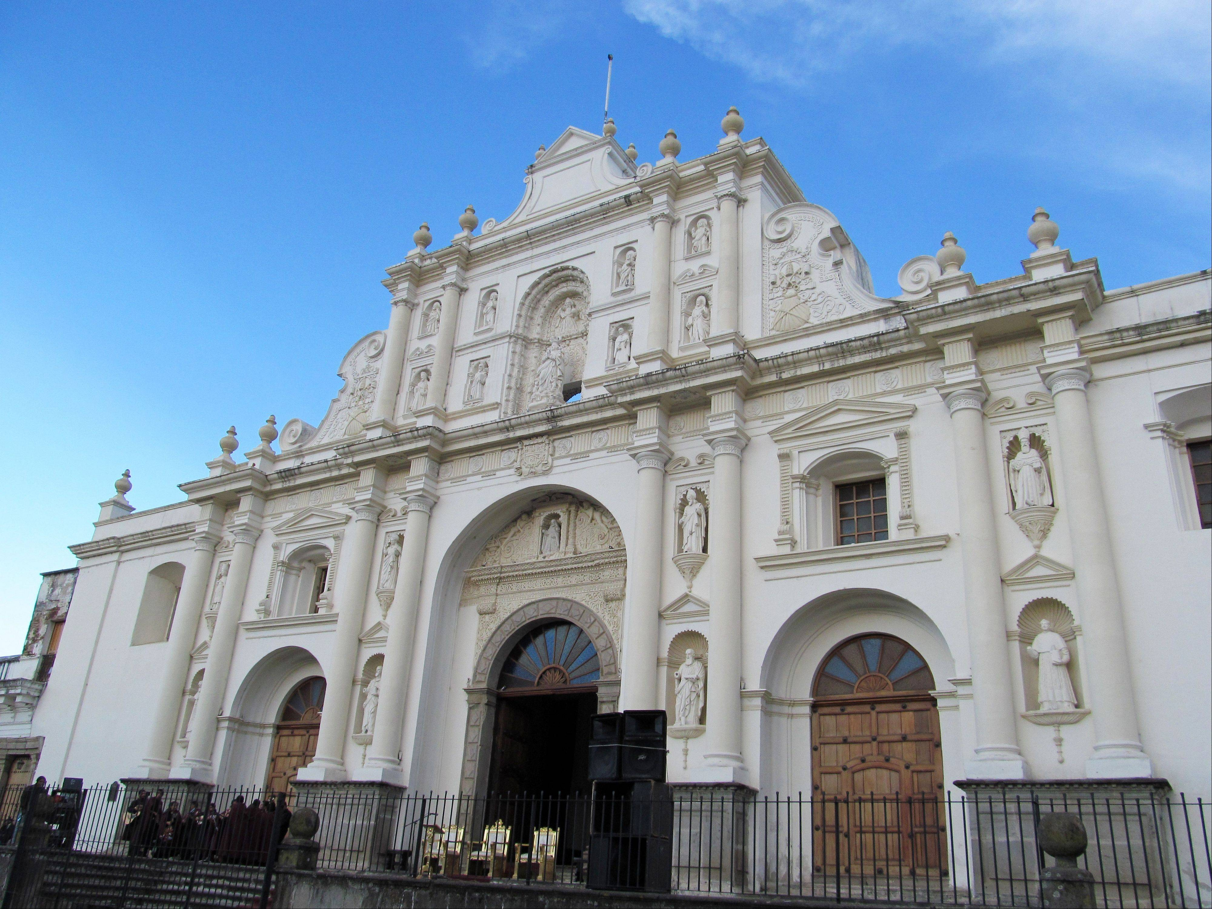 Catedral de Santiago on the main square in Antigua, Guatemala, the country's former capital. The church is considered a symbol of the city, which boasts one of the best collections of Spanish colonial buildings in the Americas and is a popular destination for tourists.