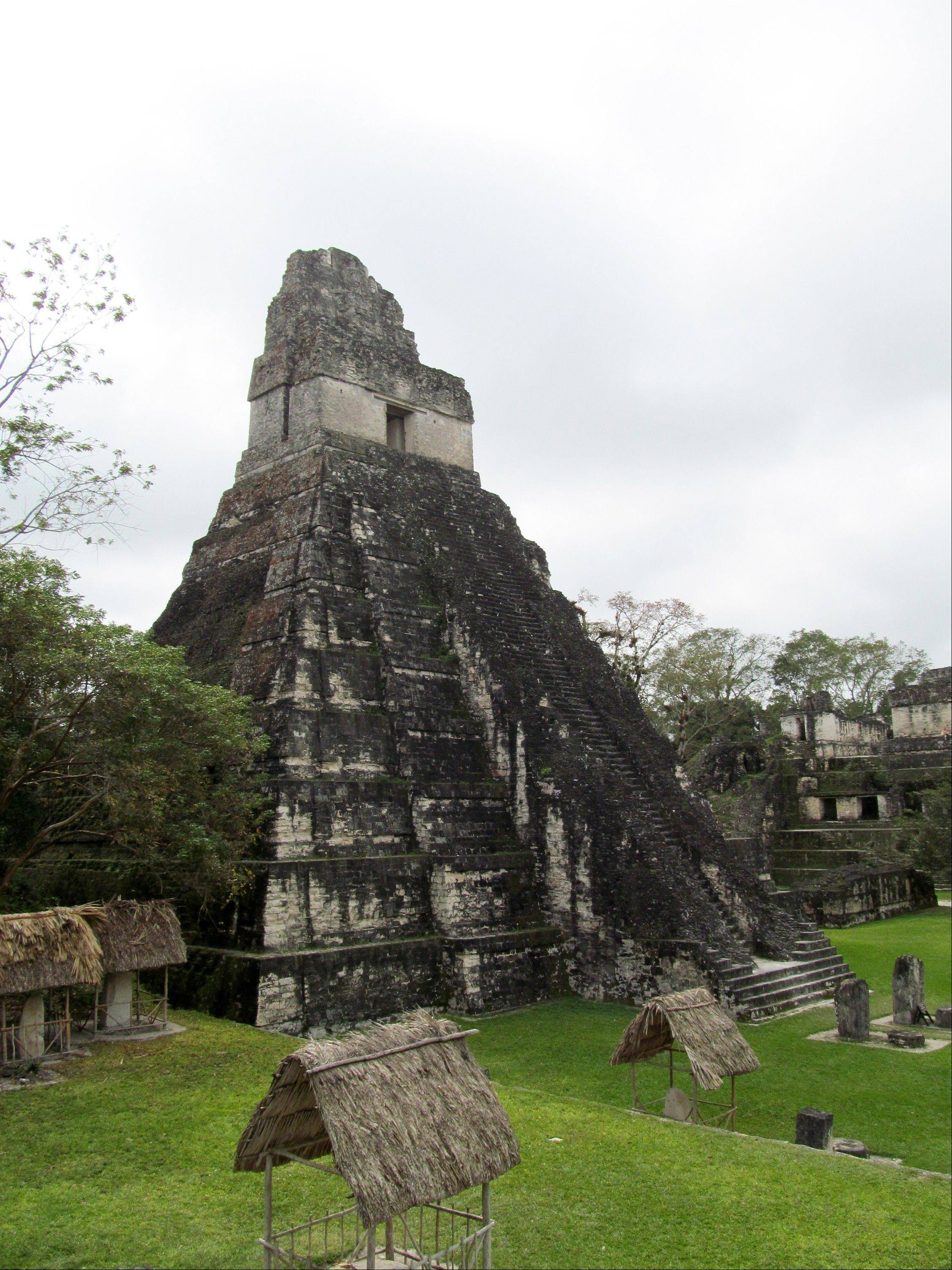 Temple I at Tikal, Guatemala's largest Mayan ruins park and a UNESCO World Heritage Site. Spread over 220 square miles, Tikal encompasses thousands of structures in addition to a primary tropical forest and a variety of wildlife.
